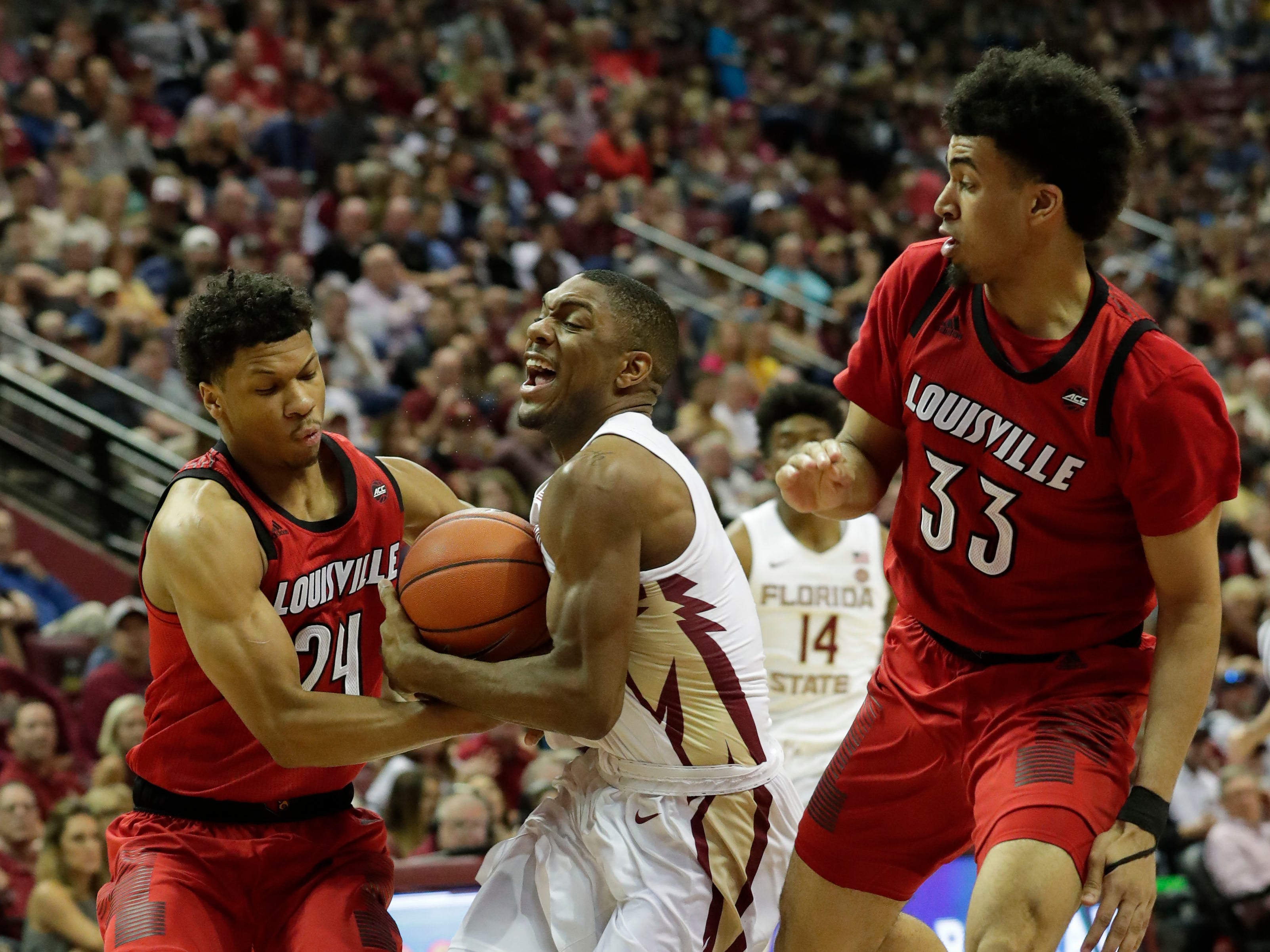 Florida State Seminoles guard Trent Forrest (3) drives the ball to the hoop while Louisville Cardinals forward Dwayne Sutton (24) tries to steal the ball. The Florida State Seminoles host the Louisville Cardinals at the Tucker Civic Center, Saturday Feb. 9, 2019.