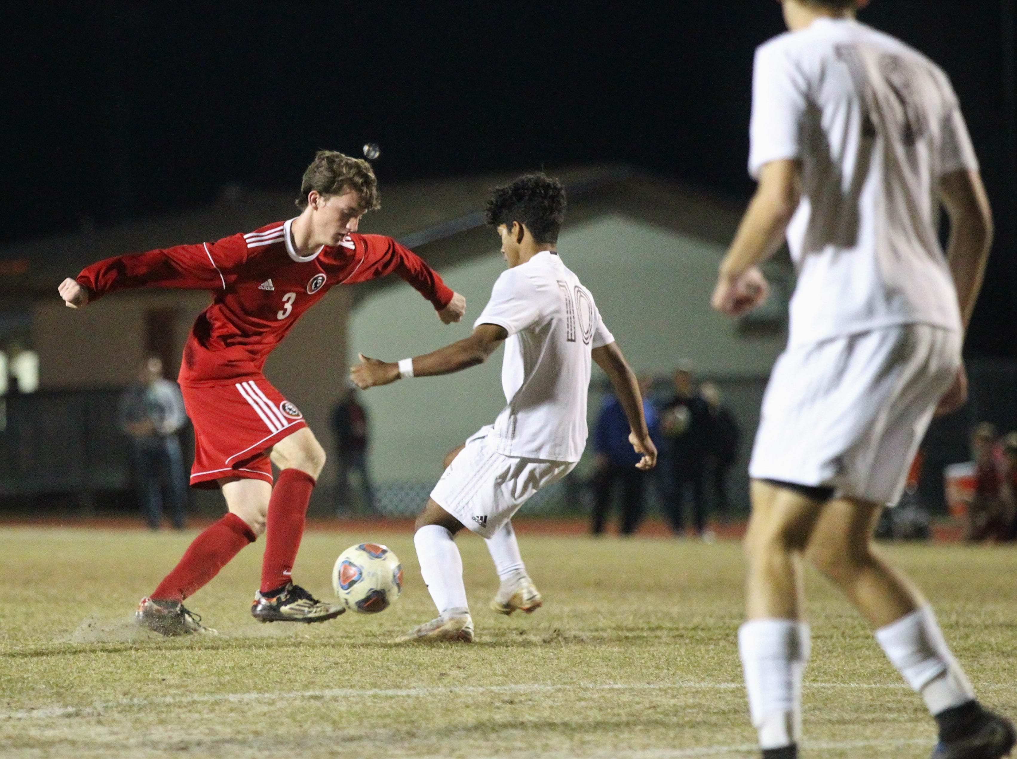 Leon's Tanner Powell dribbles in the midfield as the Lions' boys soccer team beat Niceville 1-0 in a Region 1-4A semifinal on Feb. 9, 2019.