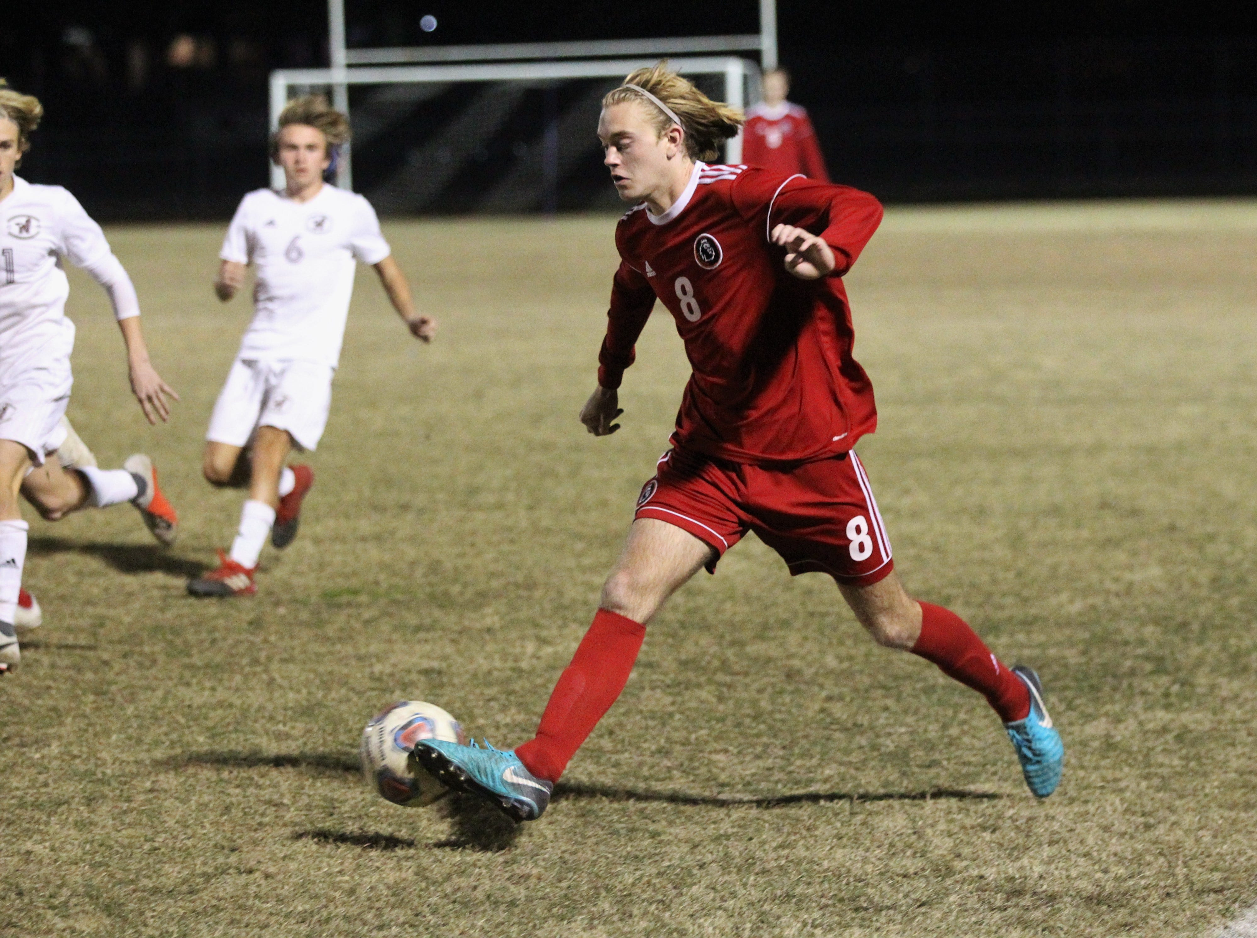 Leon's Nick Ramsden passes back inside as the Lions' boys soccer team beat Niceville 1-0 in a Region 1-4A semifinal on Feb. 9, 2019.