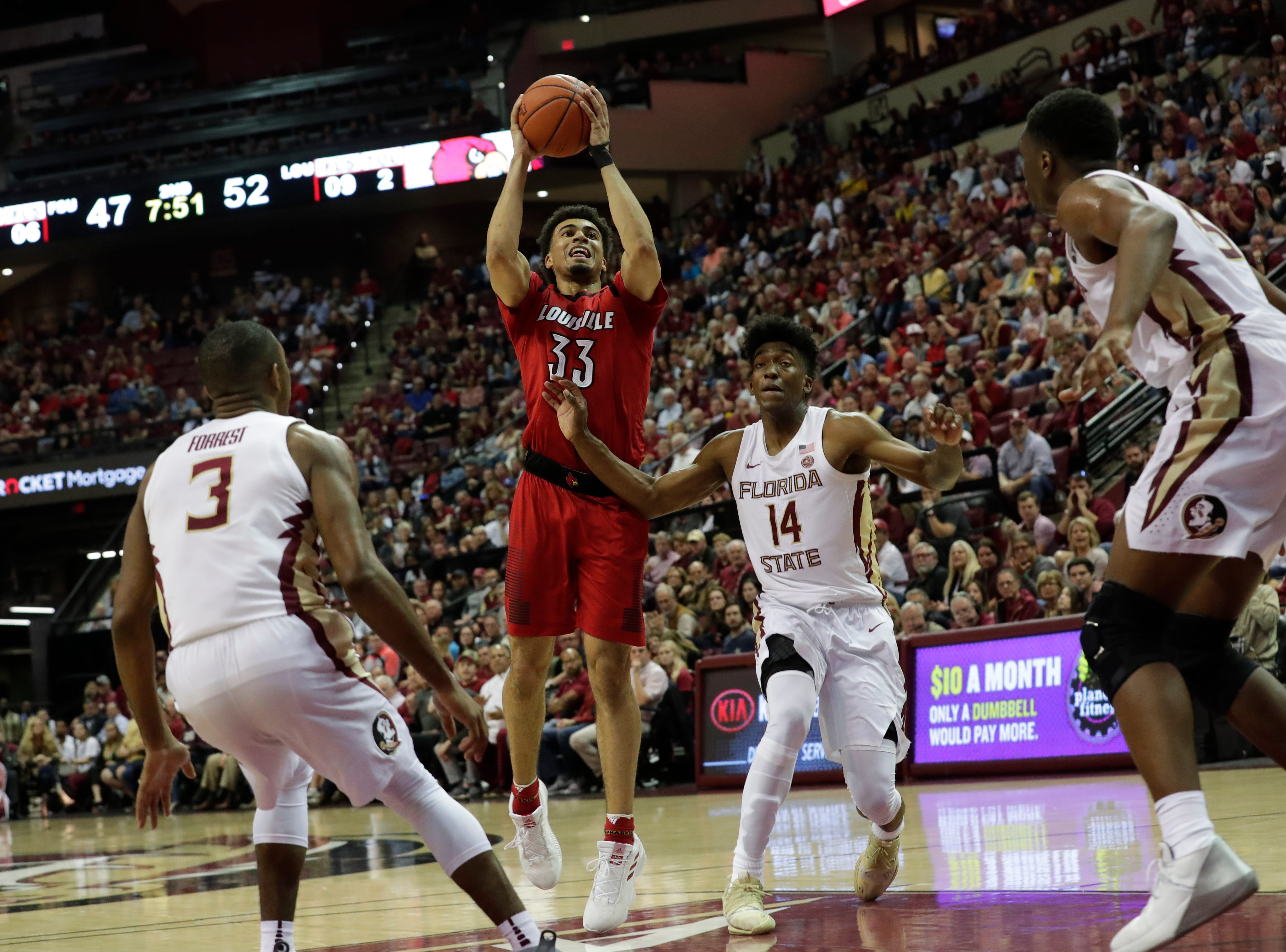 Louisville Cardinals forward Jordan Nwora (33) shoots from inside the paint over Florida State Seminoles guard Terance Mann (14), Florida State Seminoles guard Trent Forrest (3), and Florida State Seminoles forward Mfiondu Kabengele (25). The Florida State Seminoles host the Louisville Cardinals at the Tucker Civic Center, Saturday Feb. 9, 2019.