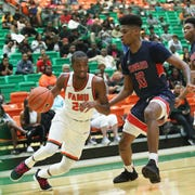 FAMU Justin Ravenl drives to the hoop against Zion Cousins of Howard. The Rattlers lost 70-66 o Saturday, Feb. 9, 2019 at the Al Lawson Multipurpose Center.