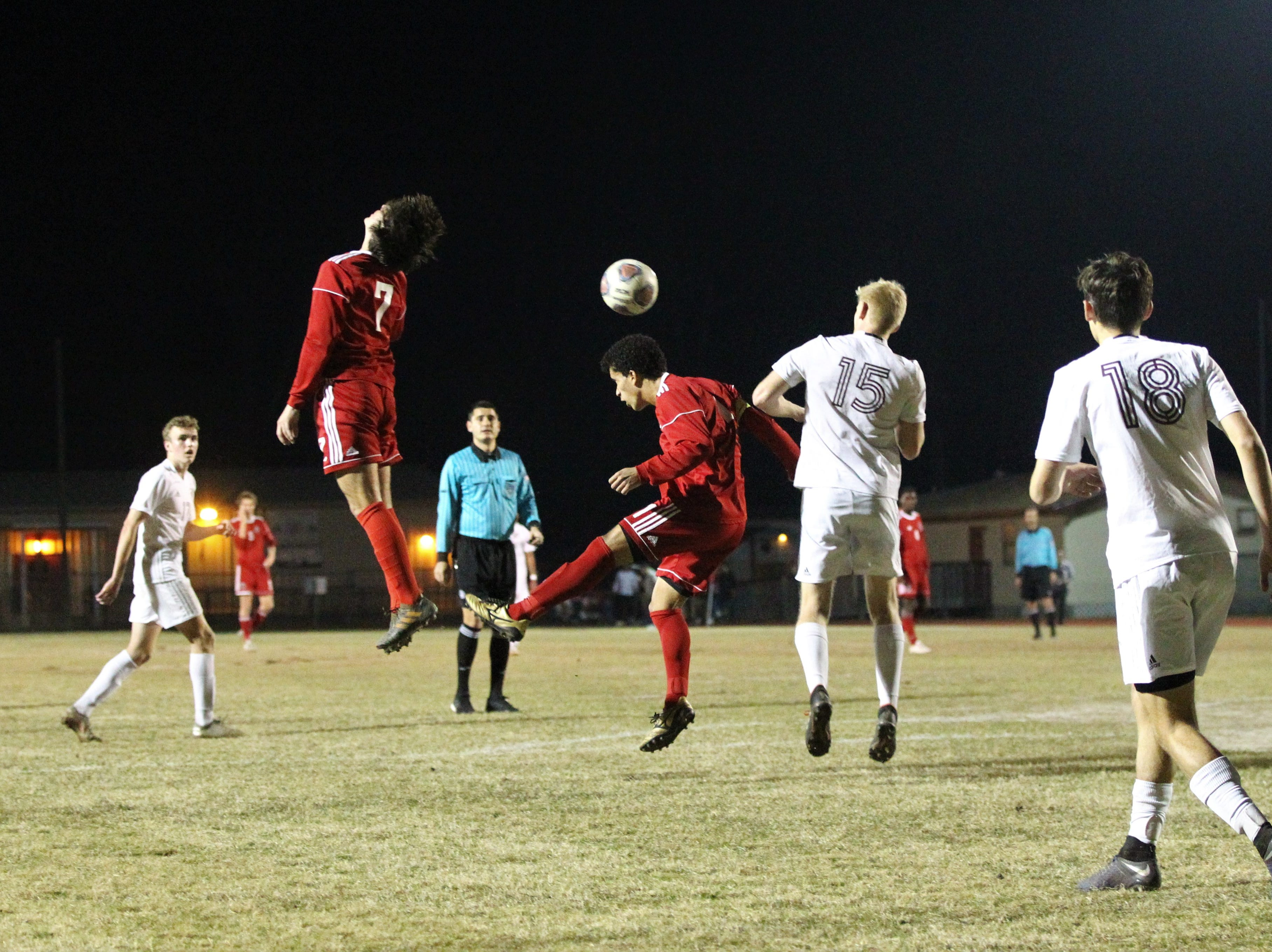 Leon's Sy Fontenot goes for a header that goes over Henry Regalado as the Lions' boys soccer team beat Niceville 1-0 in a Region 1-4A semifinal on Feb. 9, 2019.