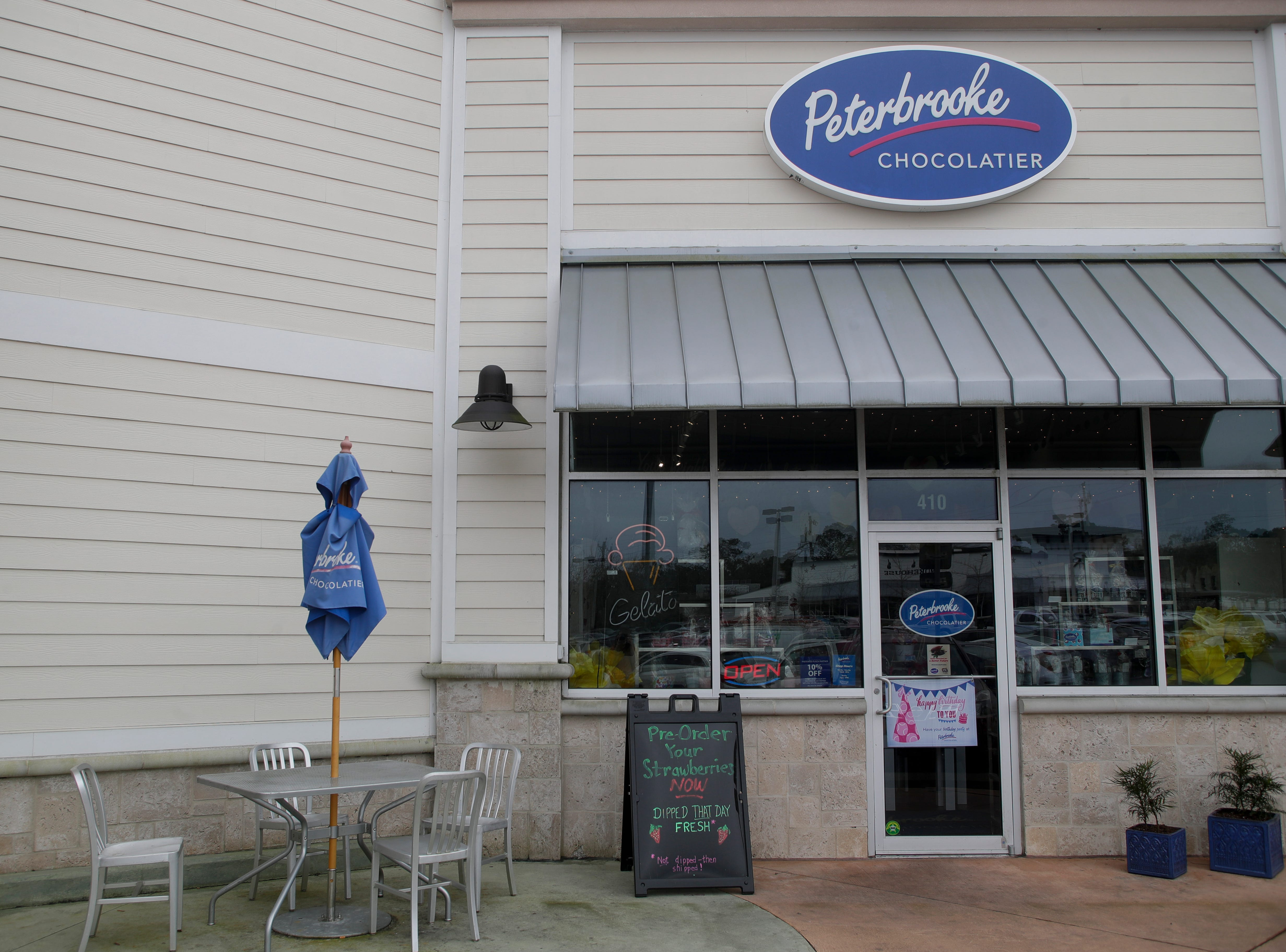 A sign in front of Peterbrooke Chocolatier, next to Whole Foods on Thomasville Road, reminds customers to pre-order their chocolate covered strawberries before Valentine's Day.
