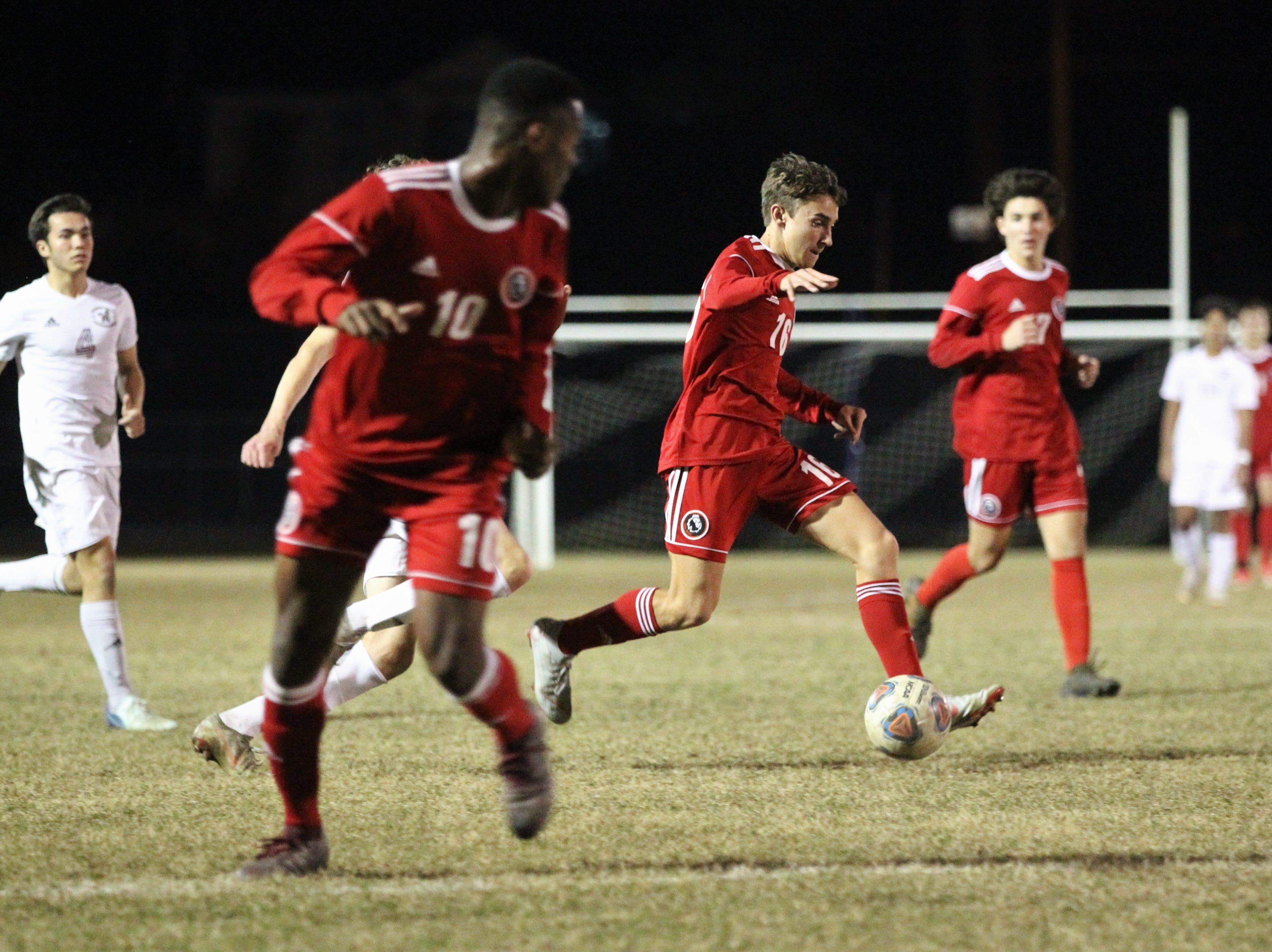 Leon's Joey Lescher dribbles in the attacking third as the Lions' boys soccer team beat Niceville 1-0 in a Region 1-4A semifinal on Feb. 9, 2019.