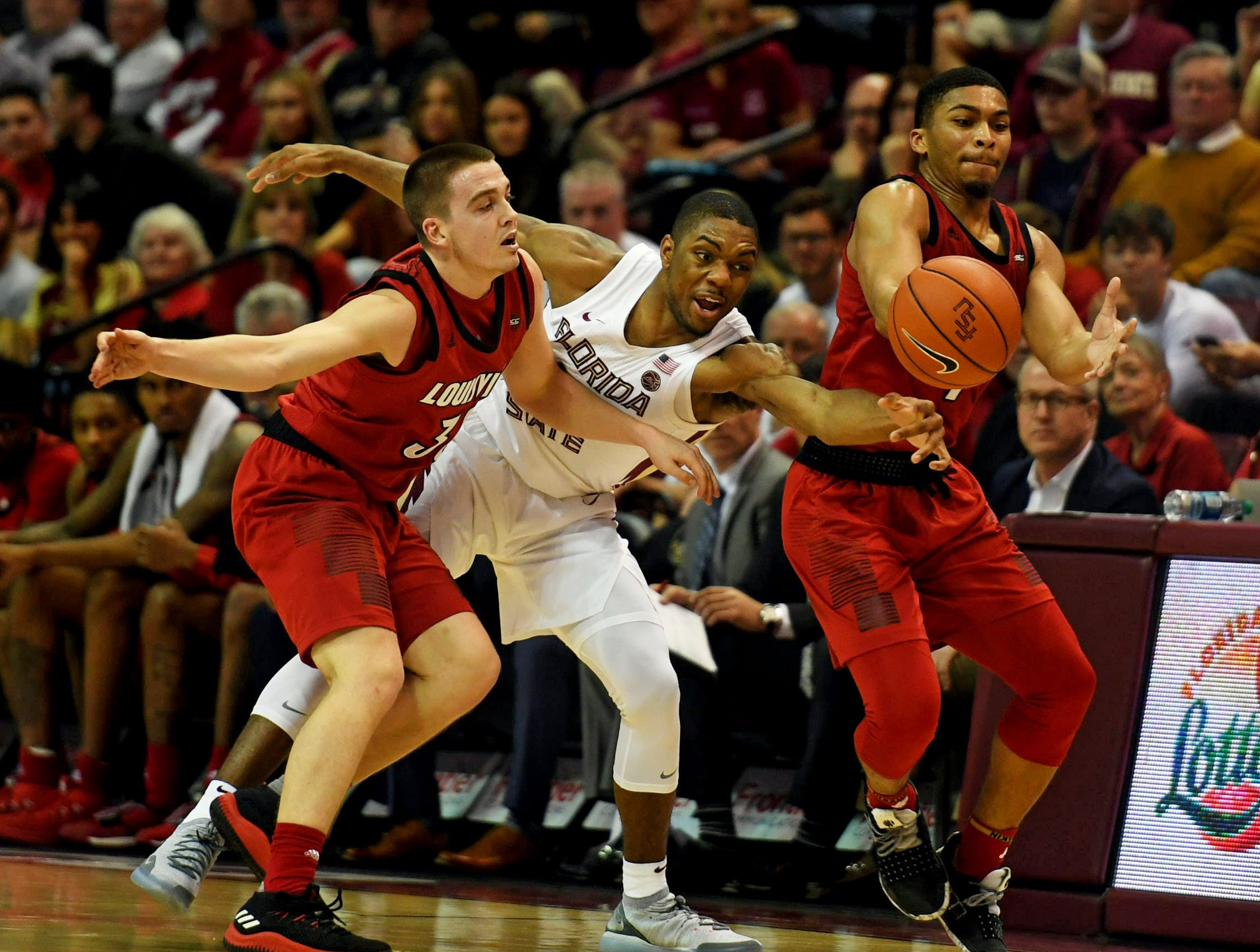 Feb 9, 2019; Tallahassee, FL, USA; Louisville Cardinals guard Ryan McMahon (30) and guard Christen Cunningham (1) have the ball knocked away by Florida State Seminoles guard Trent Forrest (3) during the second half at Donald L. Tucker Center. Mandatory Credit: Melina Myers-USA TODAY Sports