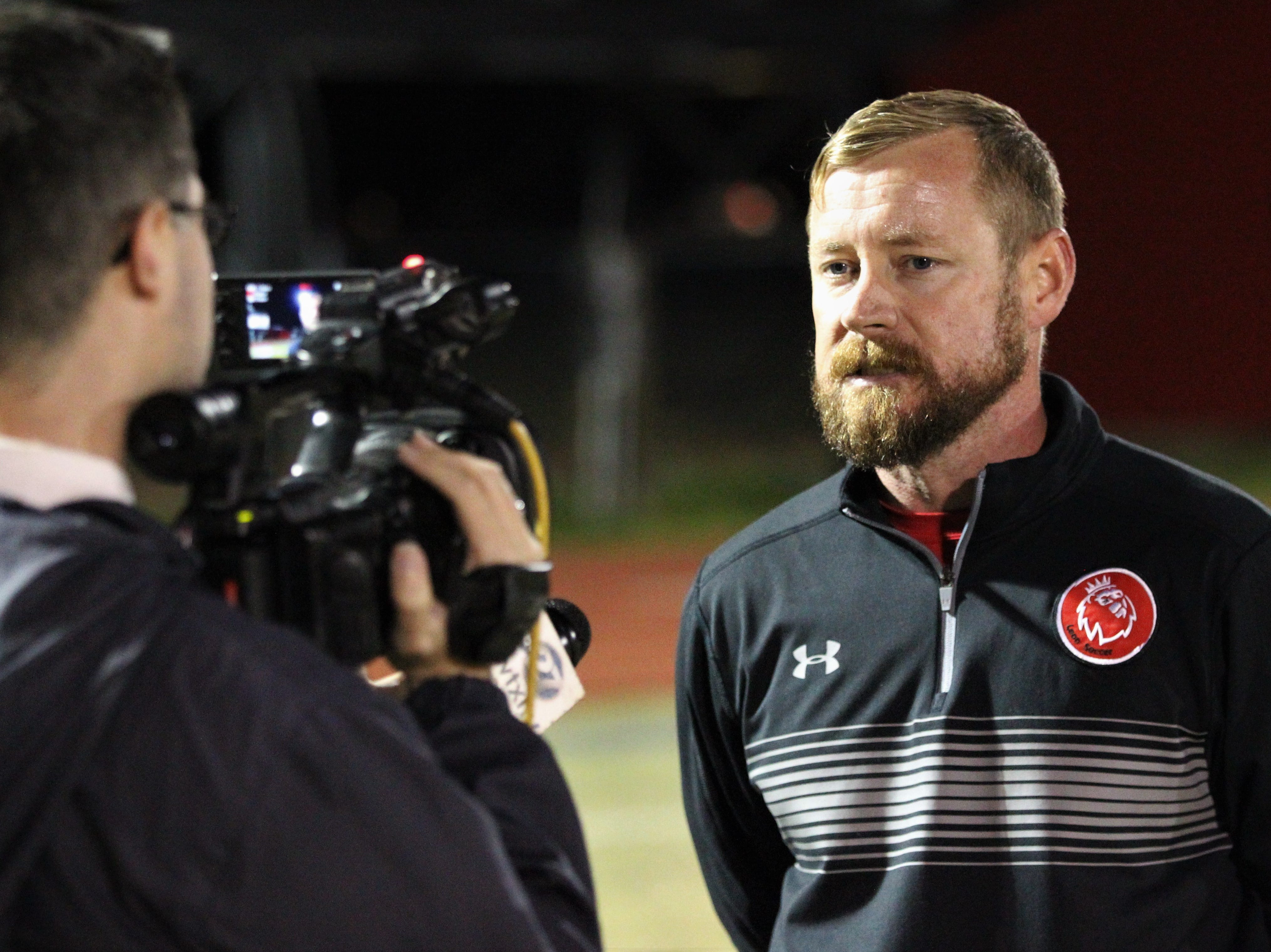 Leon boys soccer coach Jamie McBrearty gets interviewed after the Lions beat Niceville 1-0 in a Region 1-4A semifinal on Feb. 9, 2019.
