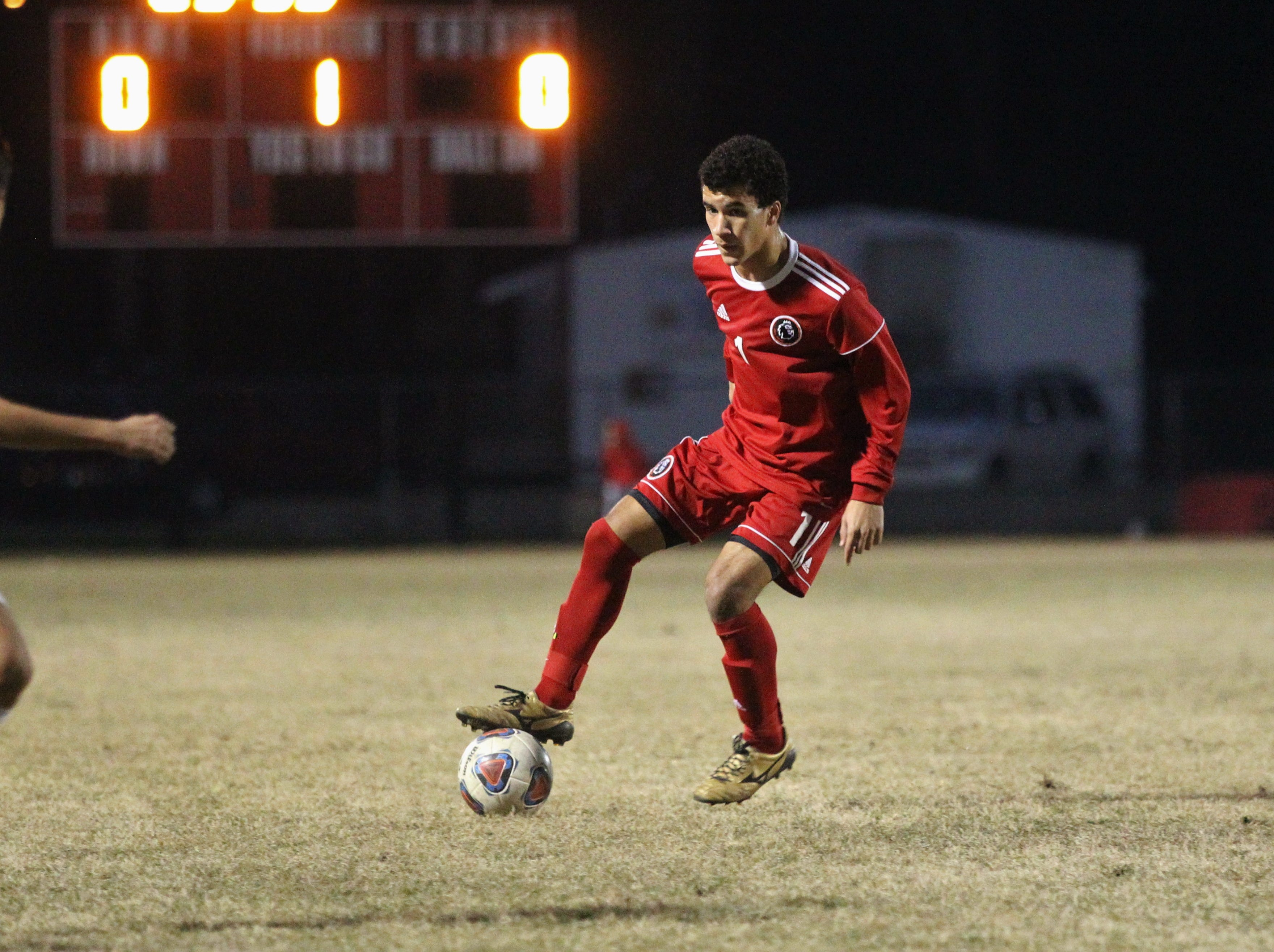Leon's  Sy Fontenot dribbles in the midfield as the Lions' boys soccer team beat Niceville 1-0 in a Region 1-4A semifinal on Feb. 9, 2019.