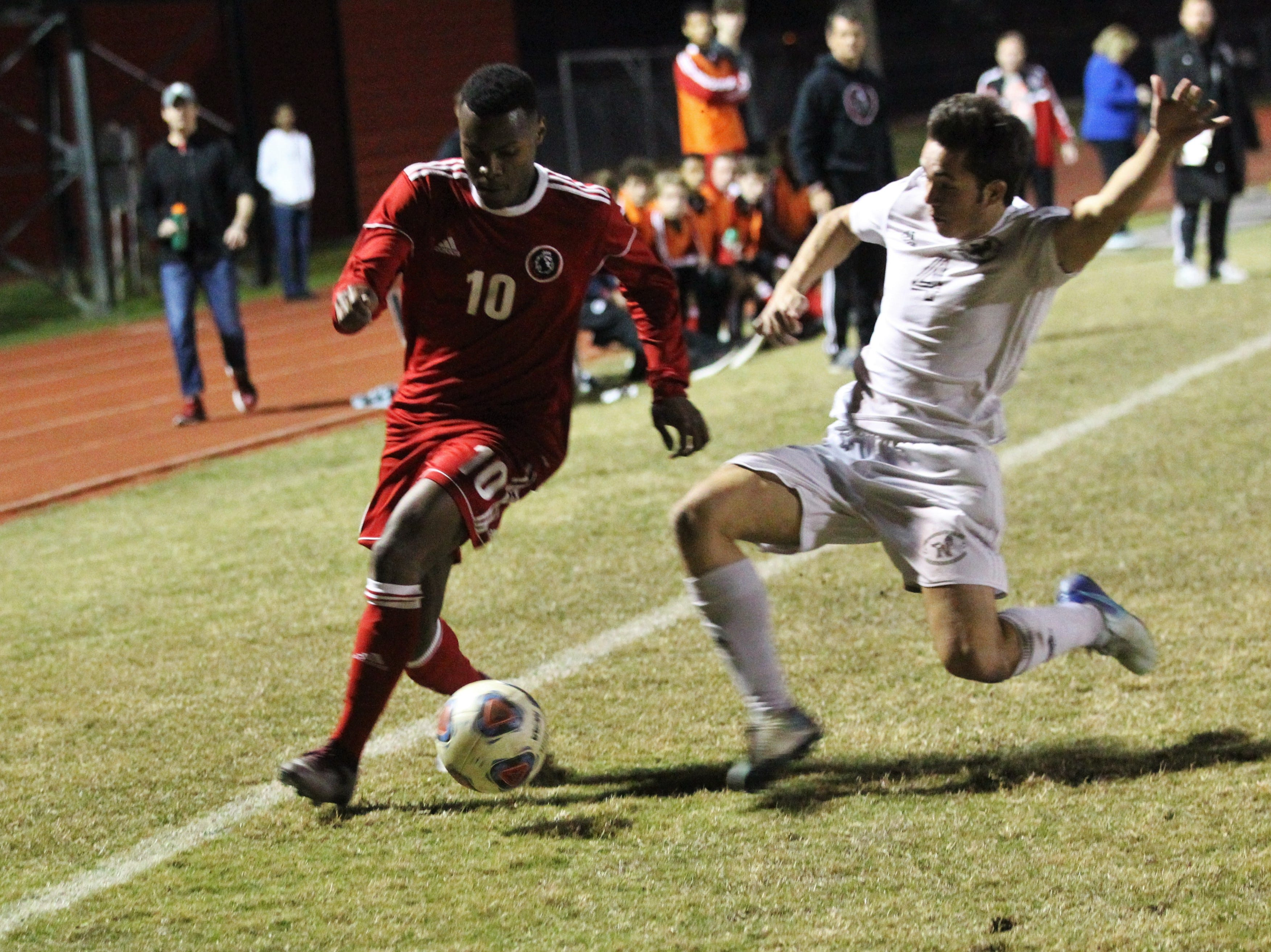 Leon's Jaden Jones-Riley tries to get past a defender as the Lions' boys soccer team beat Niceville 1-0 in a Region 1-4A semifinal on Feb. 9, 2019.