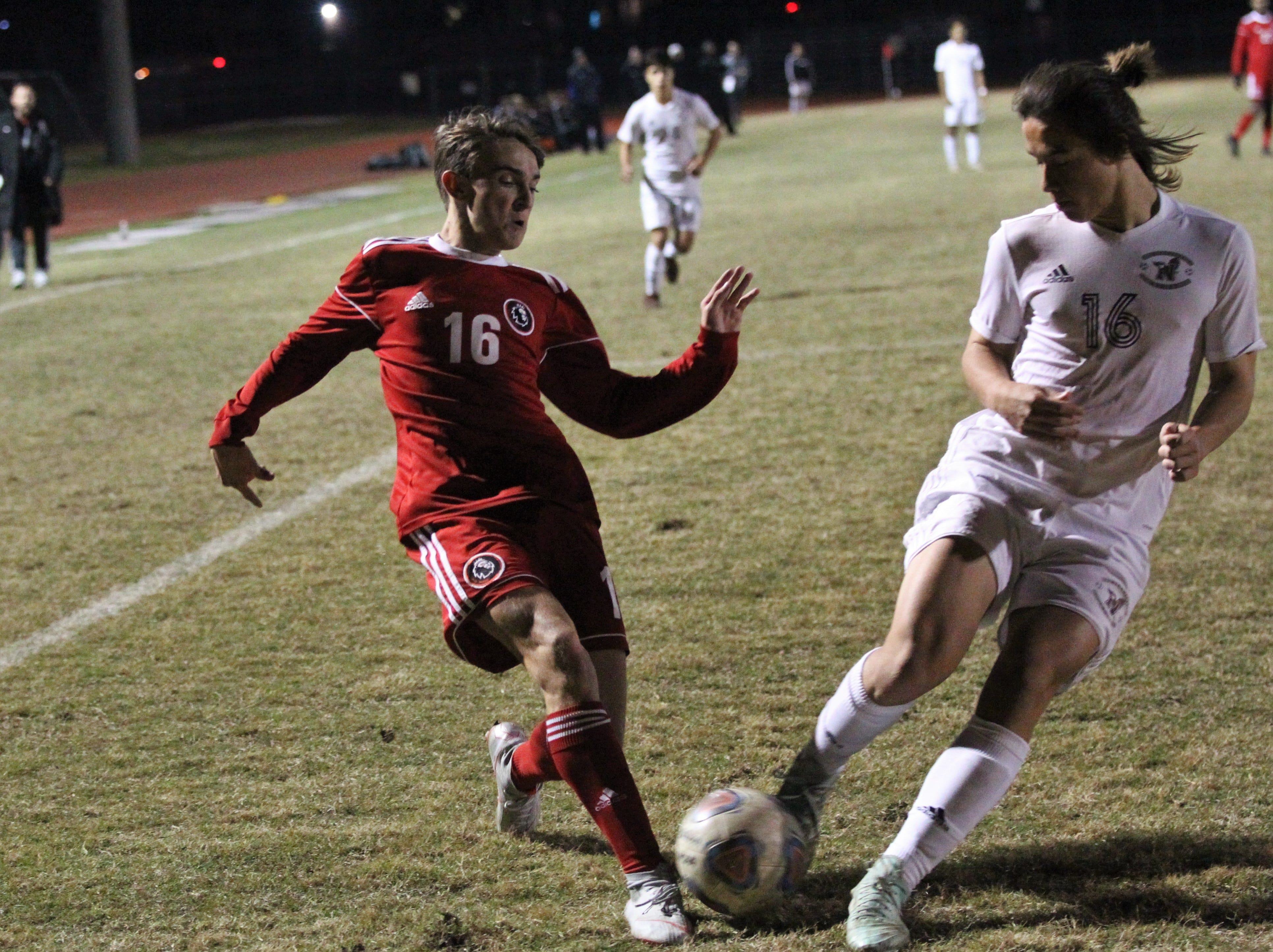 Leon's Joey Lescher has a pass disrupted as the Lions' boys soccer team beat Niceville 1-0 in a Region 1-4A semifinal on Feb. 9, 2019.