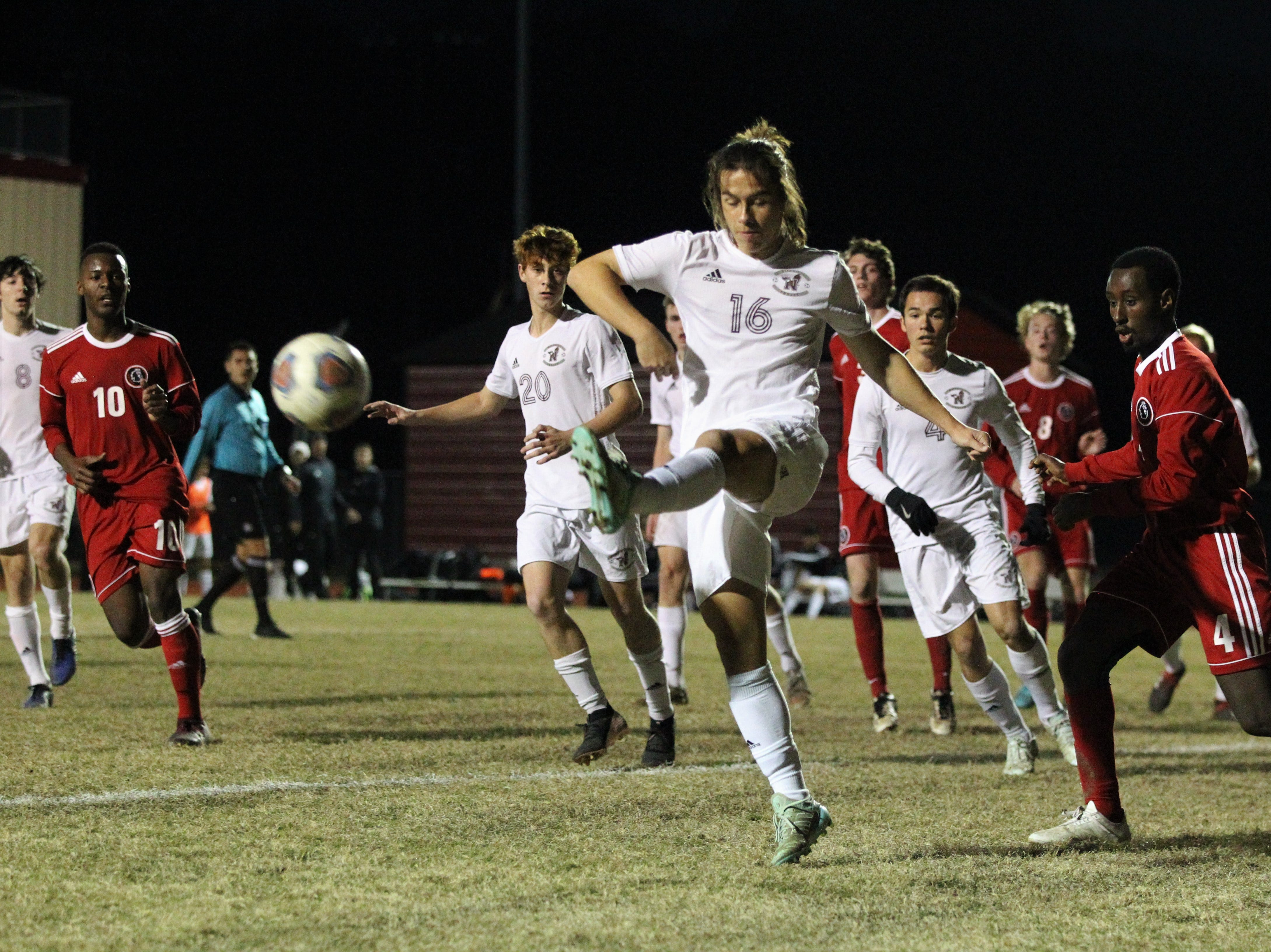 Niceville's Travis Sherwin clears a corner kick as the Leon's boys soccer team beat Niceville 1-0 in a Region 1-4A semifinal on Feb. 9, 2019.