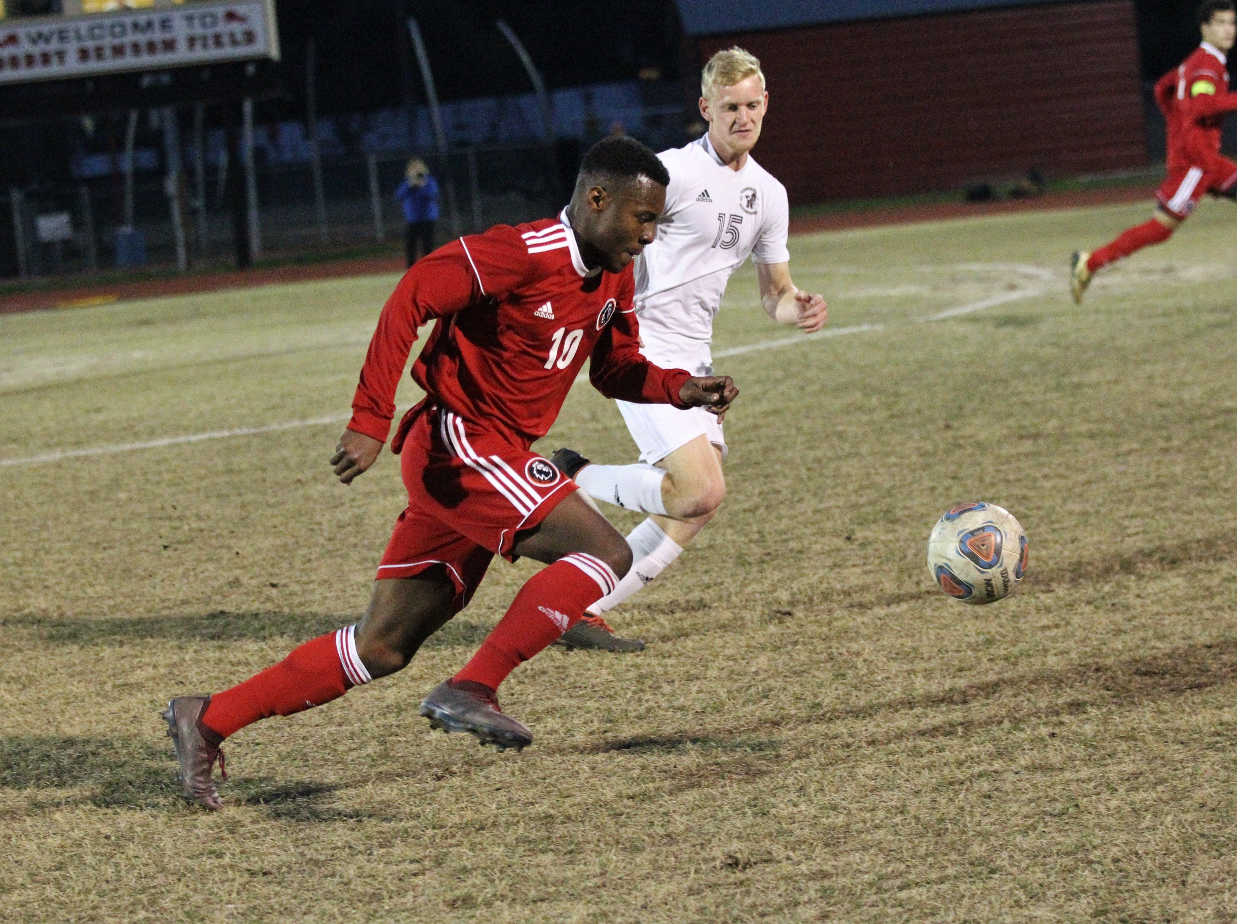 Leon's Jaden Jones-Riley dribbles upfield as the Lions' boys soccer team beat Niceville 1-0 in a Region 1-4A semifinal on Feb. 9, 2019.