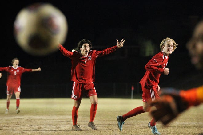 Leon's Henry Regalado reacts to Sy Fontenot's game-winning goal as the Lions' boys soccer team beat Niceville 1-0 in a Region 1-4A semifinal on Feb. 9, 2019.