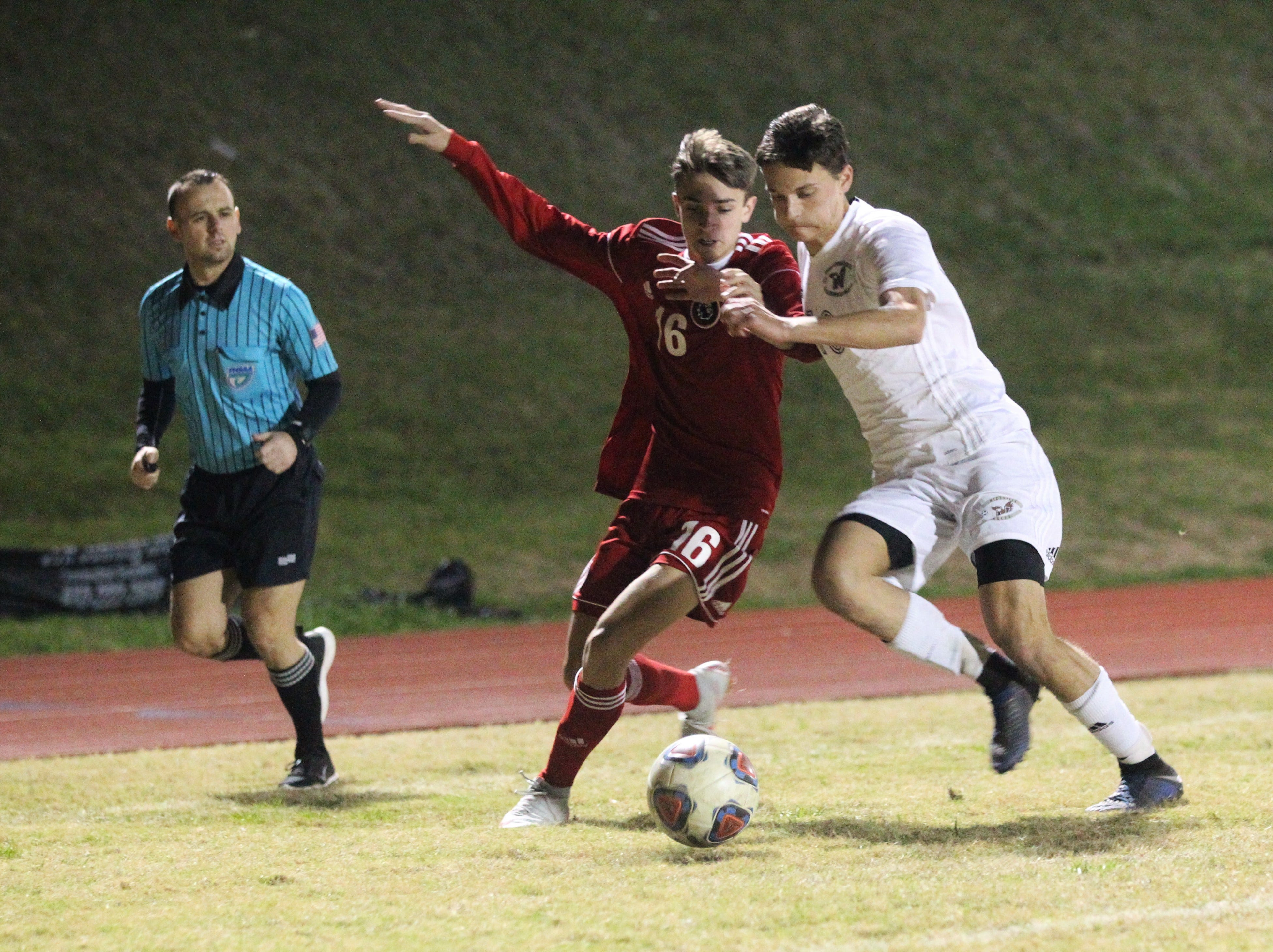 Leon's Joey Lescher fights for possession as the Lions' boys soccer team beat Niceville 1-0 in a Region 1-4A semifinal on Feb. 9, 2019.