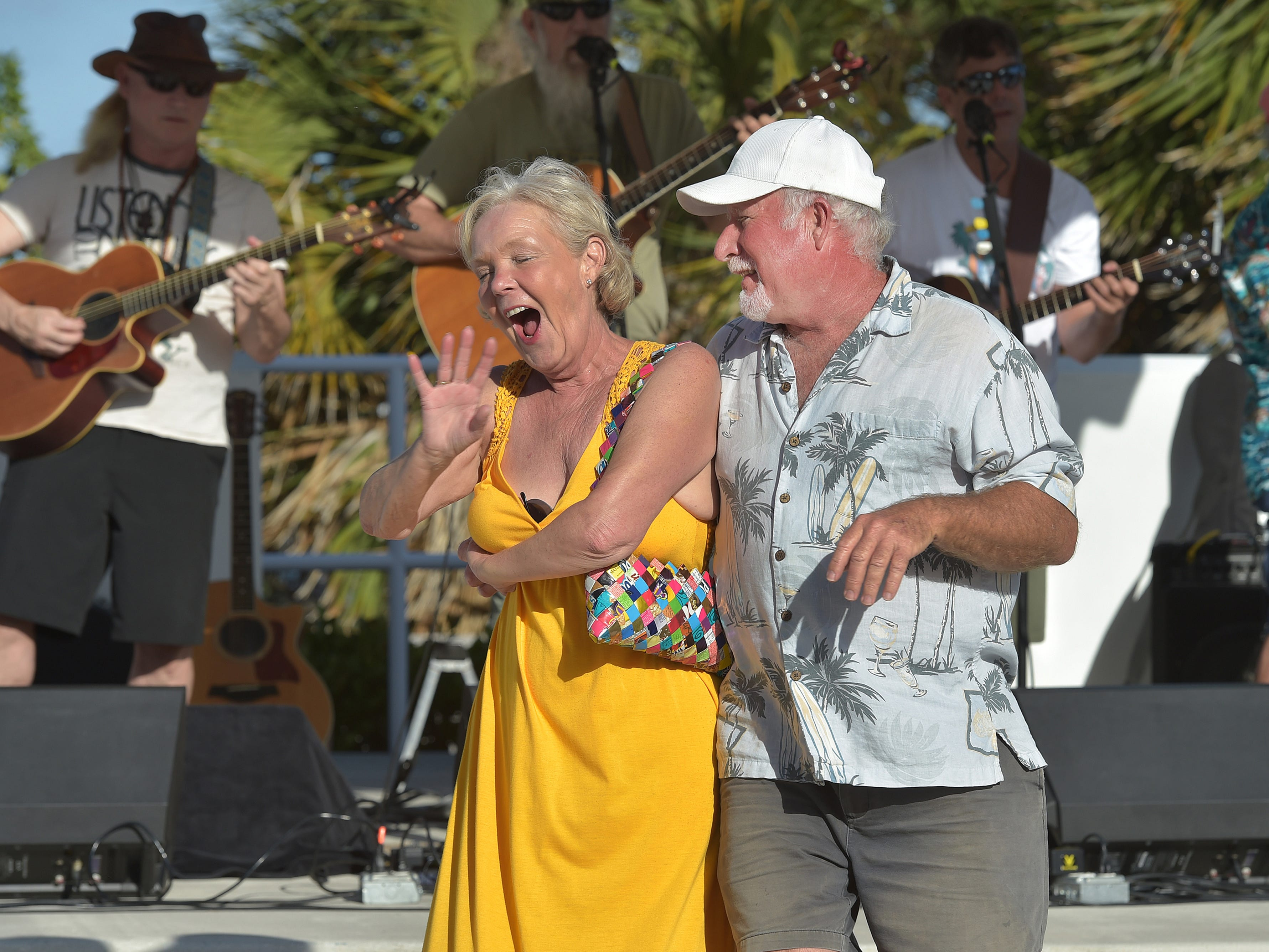 """It's such a joy, we live in one of the most beautiful places in the world,"" said Candy Darr (left), of Jensen Beach, while spinning to the music of the String Assassins, with Jon Plaster (right), of Stuart, during the Martin County Parks and Recreation's Mansion Concert Series at on the stage at the Mansion at Tuckahoe, next to Riverside Park on Sunday, Feb. 10, 2019 in Jensen Beach. ""Everyone should love to dance, because it's fun."" Darr said. Hundreds of music fans filled the grounds to enjoy the music, food beverages, and kids activities. The next concert is Sunday, March 3, 2019  at 3 p.m. to 6 p.m. with the sounds of The Floridian Band."