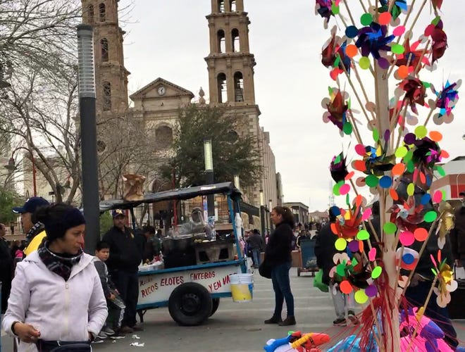 Vendors, music and street performers make for a colorful atmosphere in the plaza in front of Our Lady of Guadalupe Cathedral in downtown Juarez, Mexico.