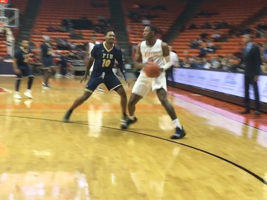 UTEP's Nigel Hawkins looks for an opening against the defense of Florida International's Devon Andrews Saturday night at the Don Haskins Center