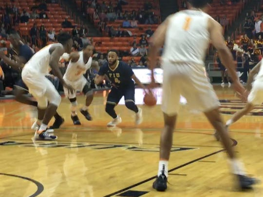 Florida International's Brian Beard drives against the UTEP defense Saturday night at the Don Haskins Center