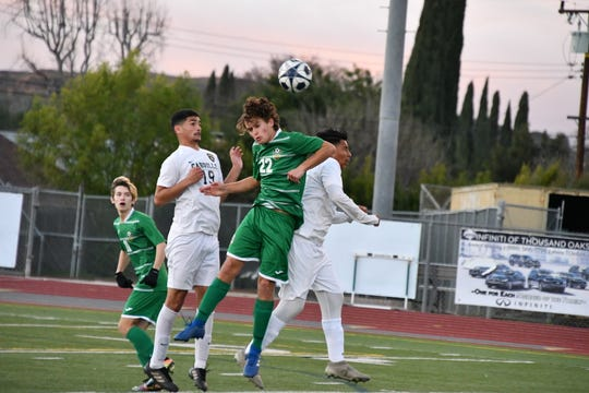 Thousand Oaks High's Coleman Bumbarger leaps to win a header against Long Beach-Cabrillo on Saturday night in the second round of the CIF-Southern Section Division 2 playoffs in Thousand Oaks. Cabrillo won, 2-0.