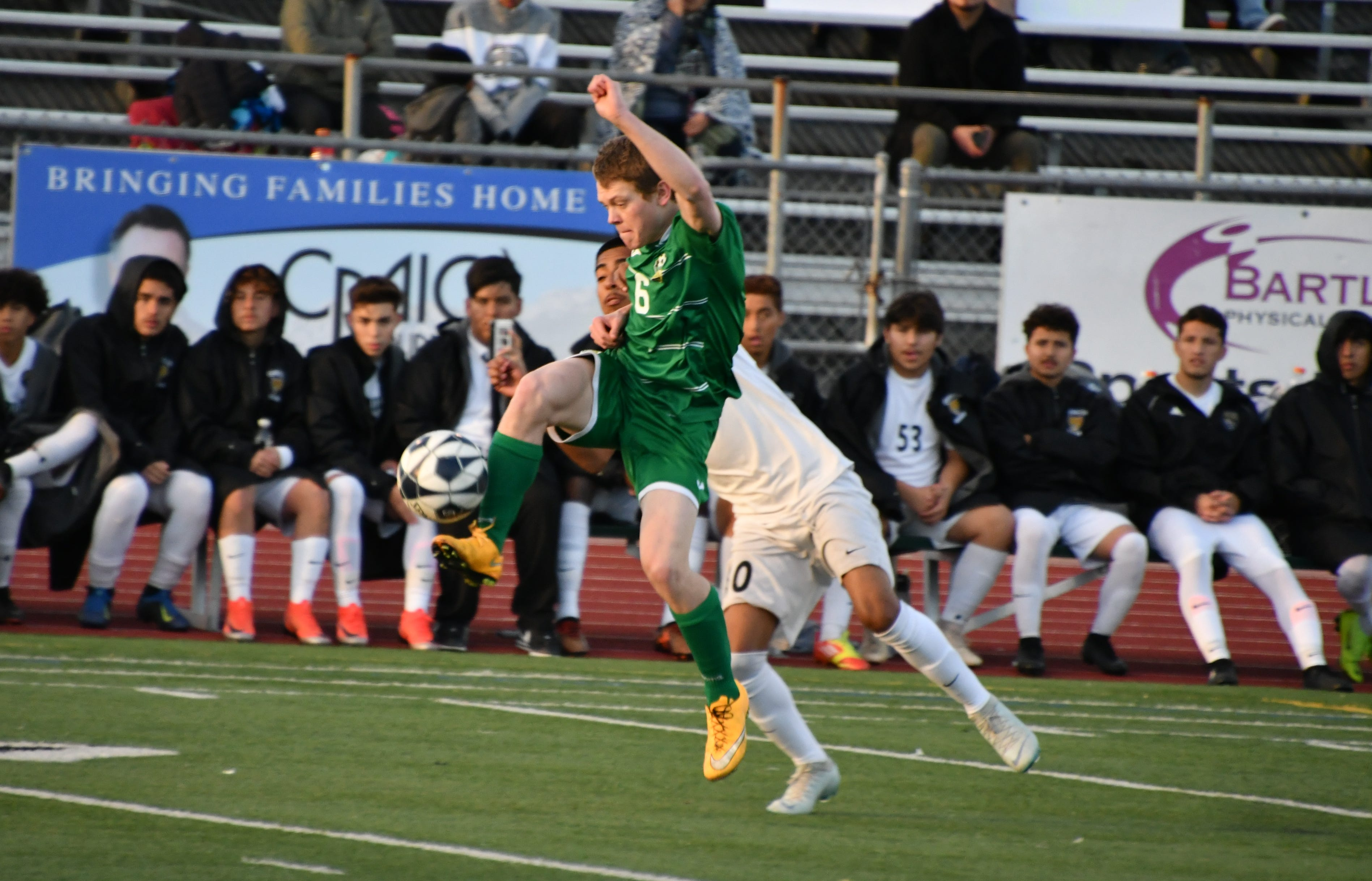 Thousand Oaks High's Jack Medley plays the ball against Long Beach-Cabrillo on Saturday night In the second round of the CIF-Southern Section Division 2 playoffs in Thousand Oaks. Cabrillo won, 2-0.