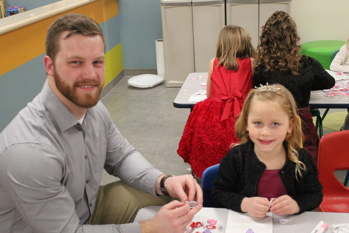 Fathers and daughters enjoy a night out at the annual Woodson YMCA Father Daughter dance. The night included plenty of opportunities to craft together.