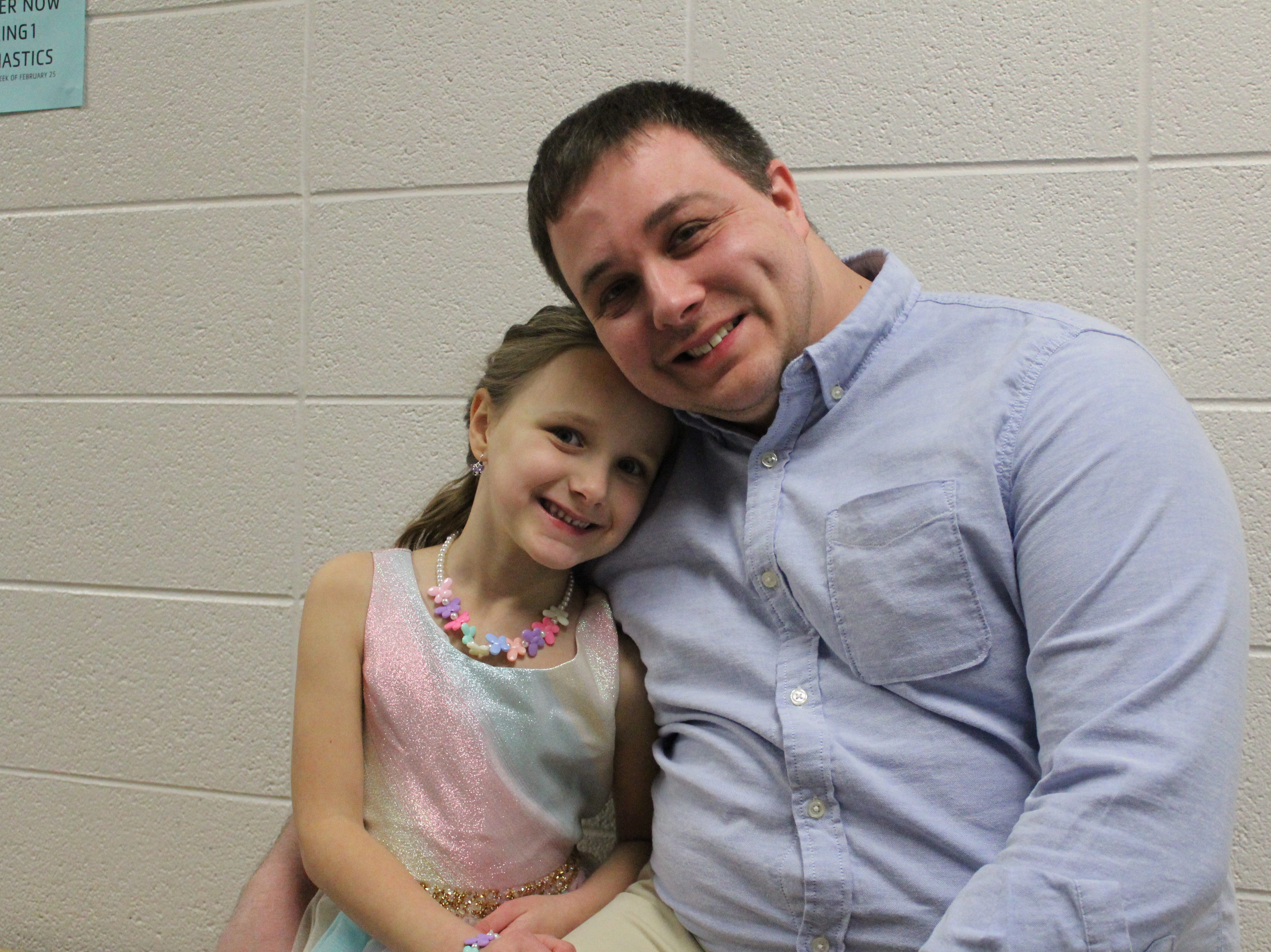 Fathers and daughters enjoy a night out at the annual Woodson YMCA Father Daughter dance.