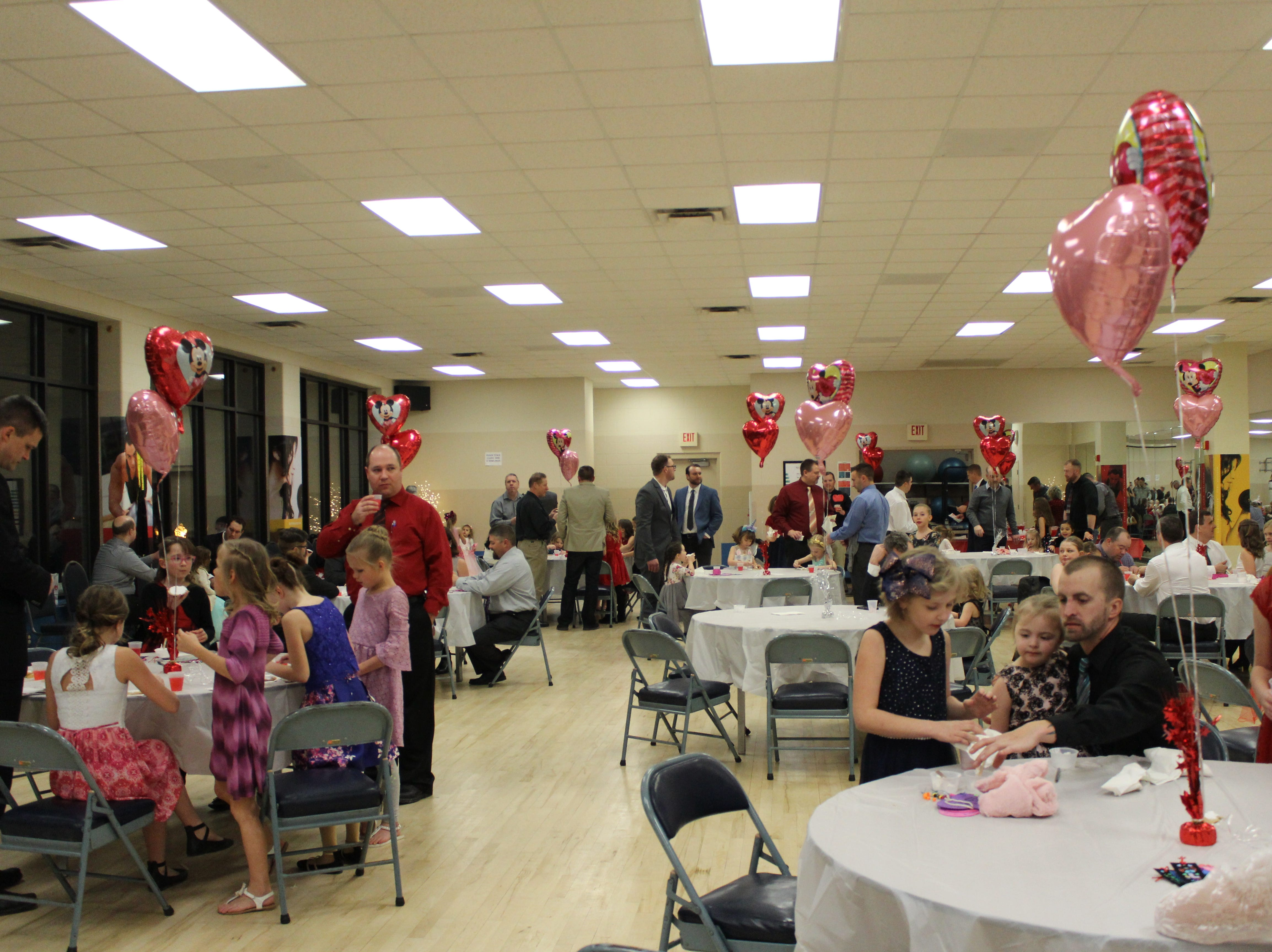 Fathers and daughters enjoy a night out at the annual Woodson YMCA Father Daughter dance, complete with snacks and punch, of course.