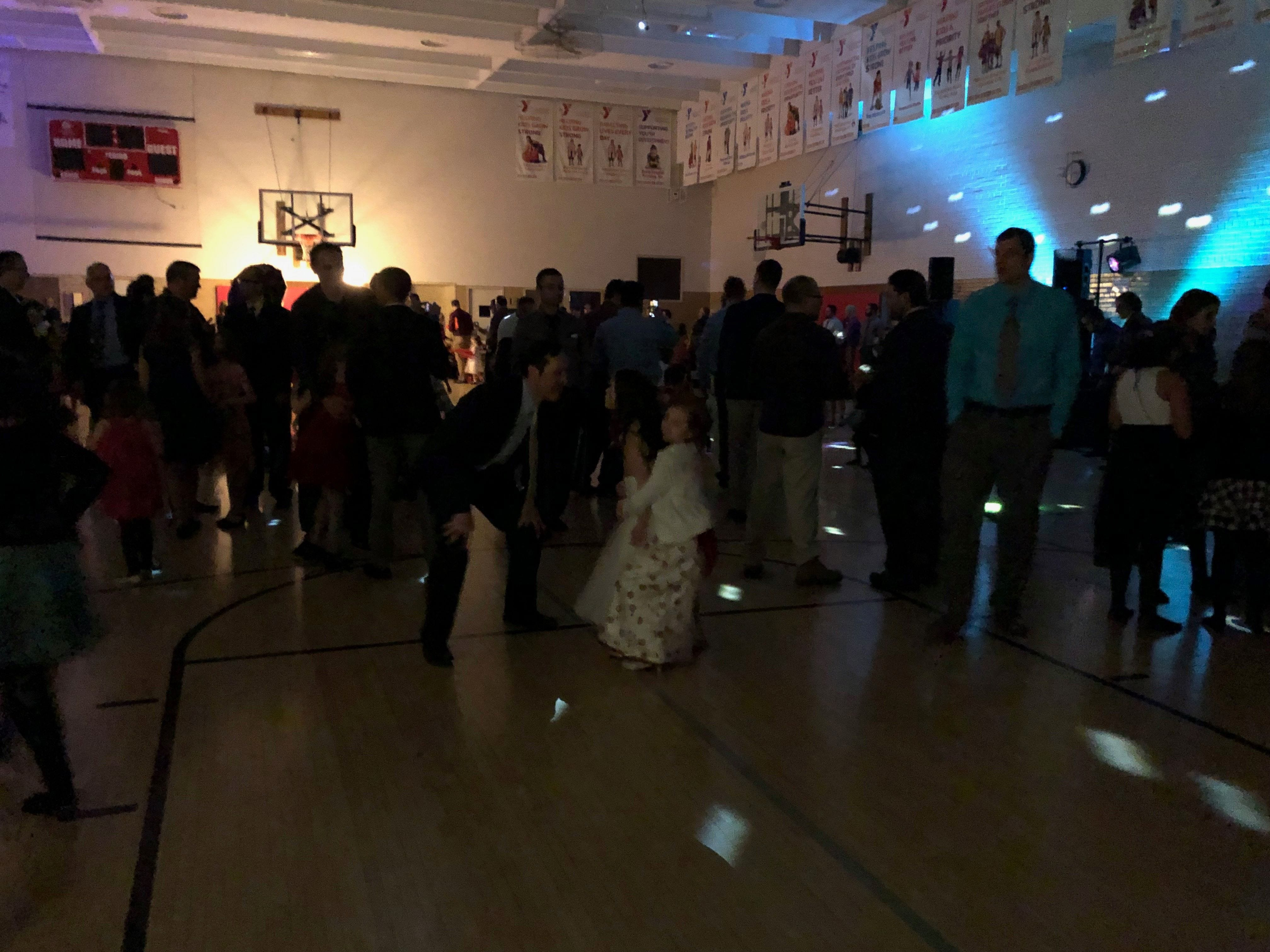 Fathers and daughters enjoy a night out at the annual Woodson YMCA Father Daughter dance, which included plenty of space to twirl around on the dance floor.
