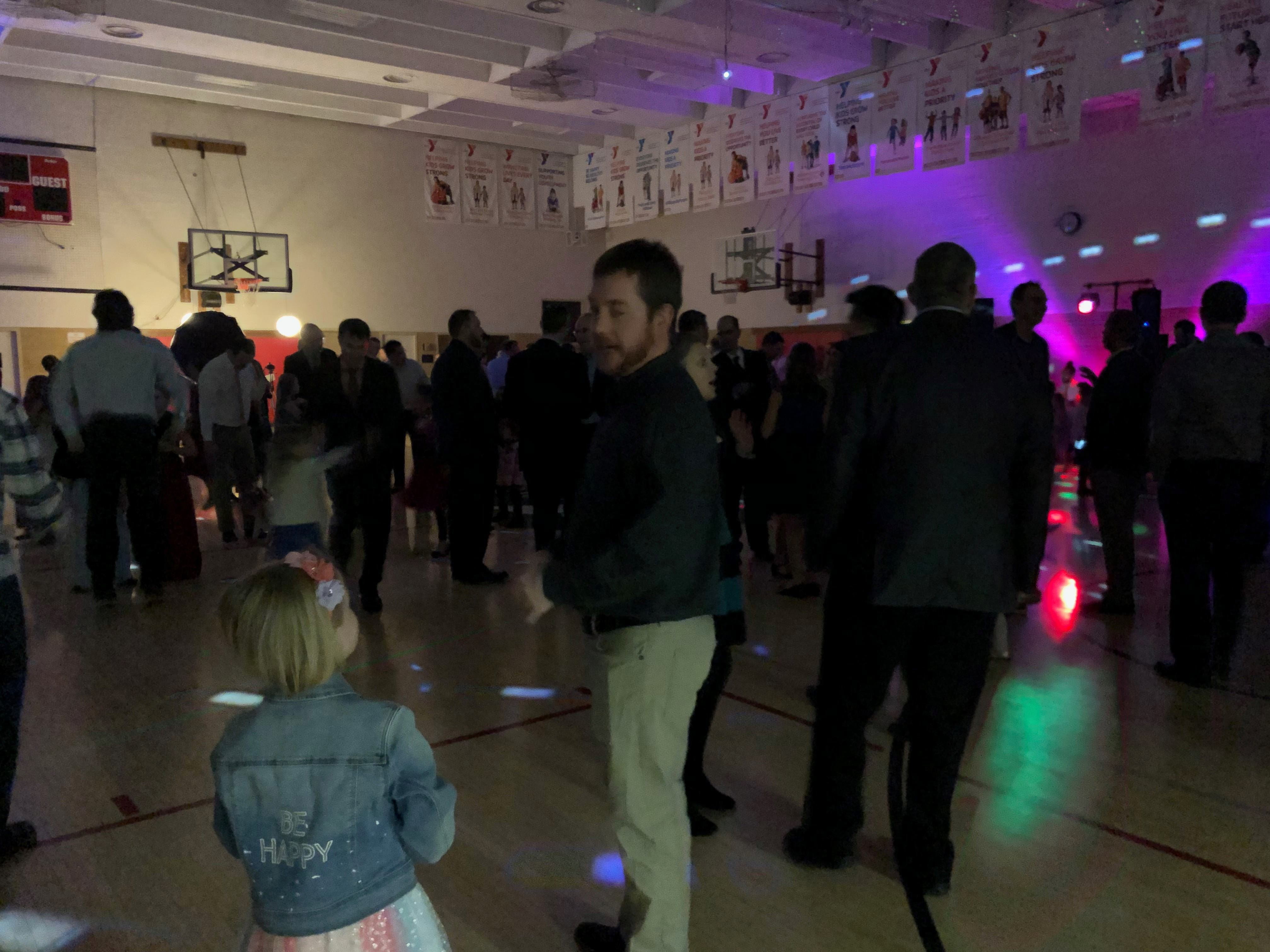 Fathers and daughters enjoy a night out at the annual Woodson YMCA Father Daughter dance, which included a dance floor in the basketball gym.