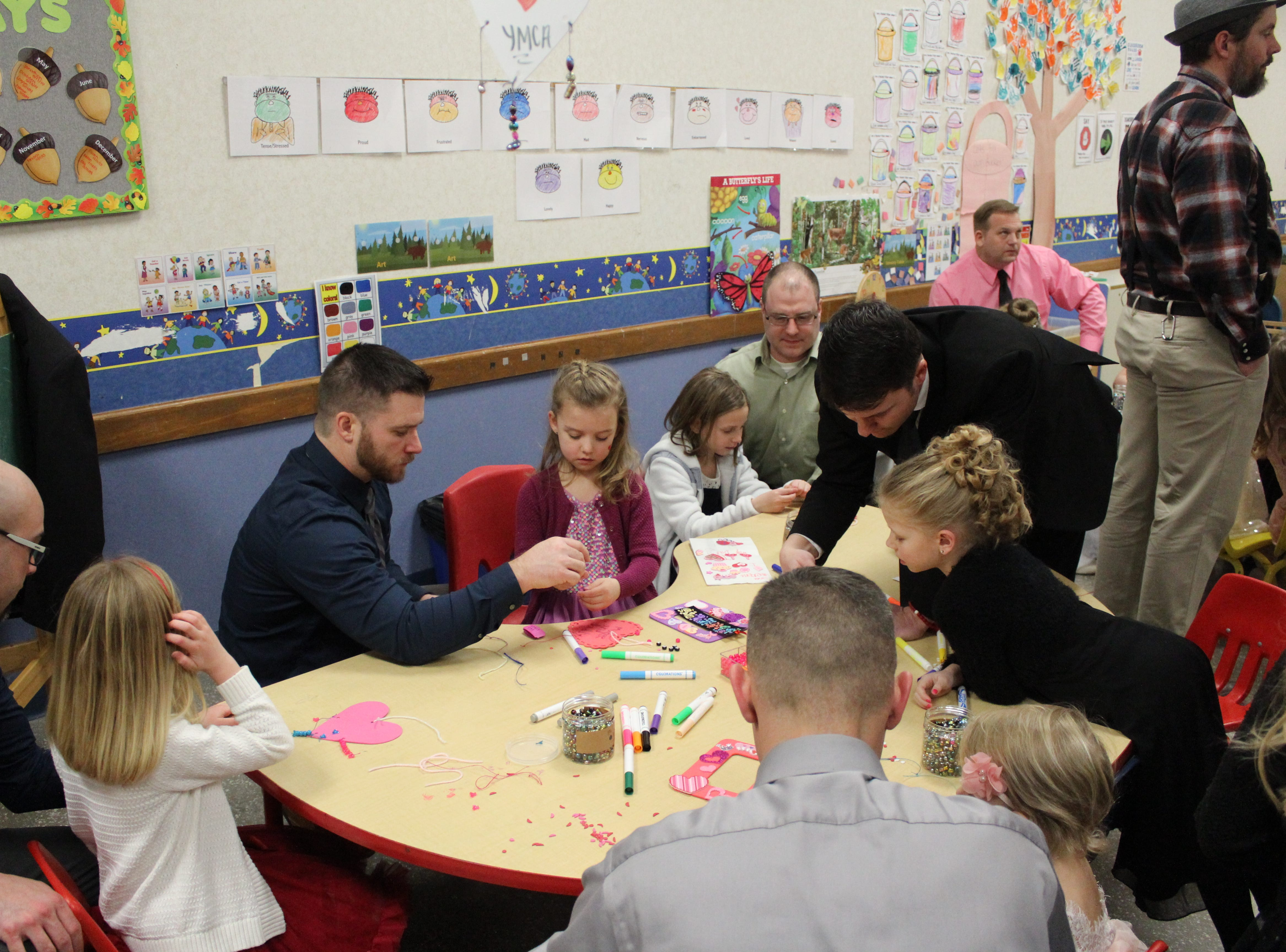 Fathers and daughters enjoy a night out at the annual Woodson YMCA Father Daughter dance. Fathers got to help their daughters assemble Valentines in one room.