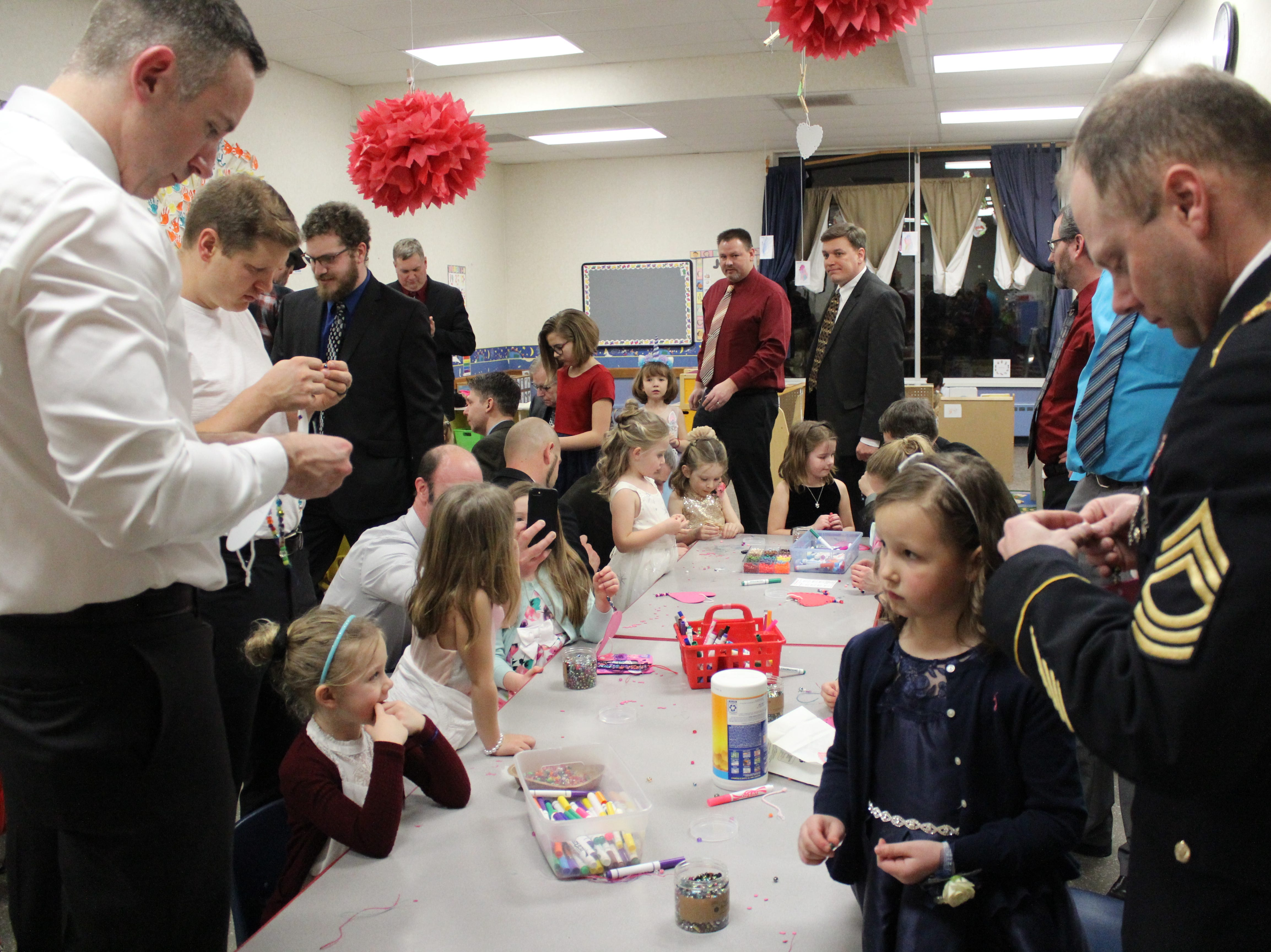 Fathers and daughters enjoy a night out at the annual Woodson YMCA Father Daughter dance. There were several craft stations throughout the building with Valentine's Day-themed goodies.