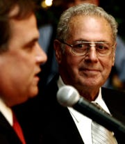 Leonard Spano, right, listens to New Rochelle Mayor Tim Idoni during a non-partisan gala to honor the retiring Westchester County clerk at the Polish Community Center in Yonkers Nov. 29, 2005.
