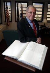 -County Clerk Leonard Spano, photographed in his White Plains office Dec. 30, 2005. The ledger he is photographed with is the book that all public officials must sign following their oath by the county clerk.( Tom Nycz / The Journal News ) rw