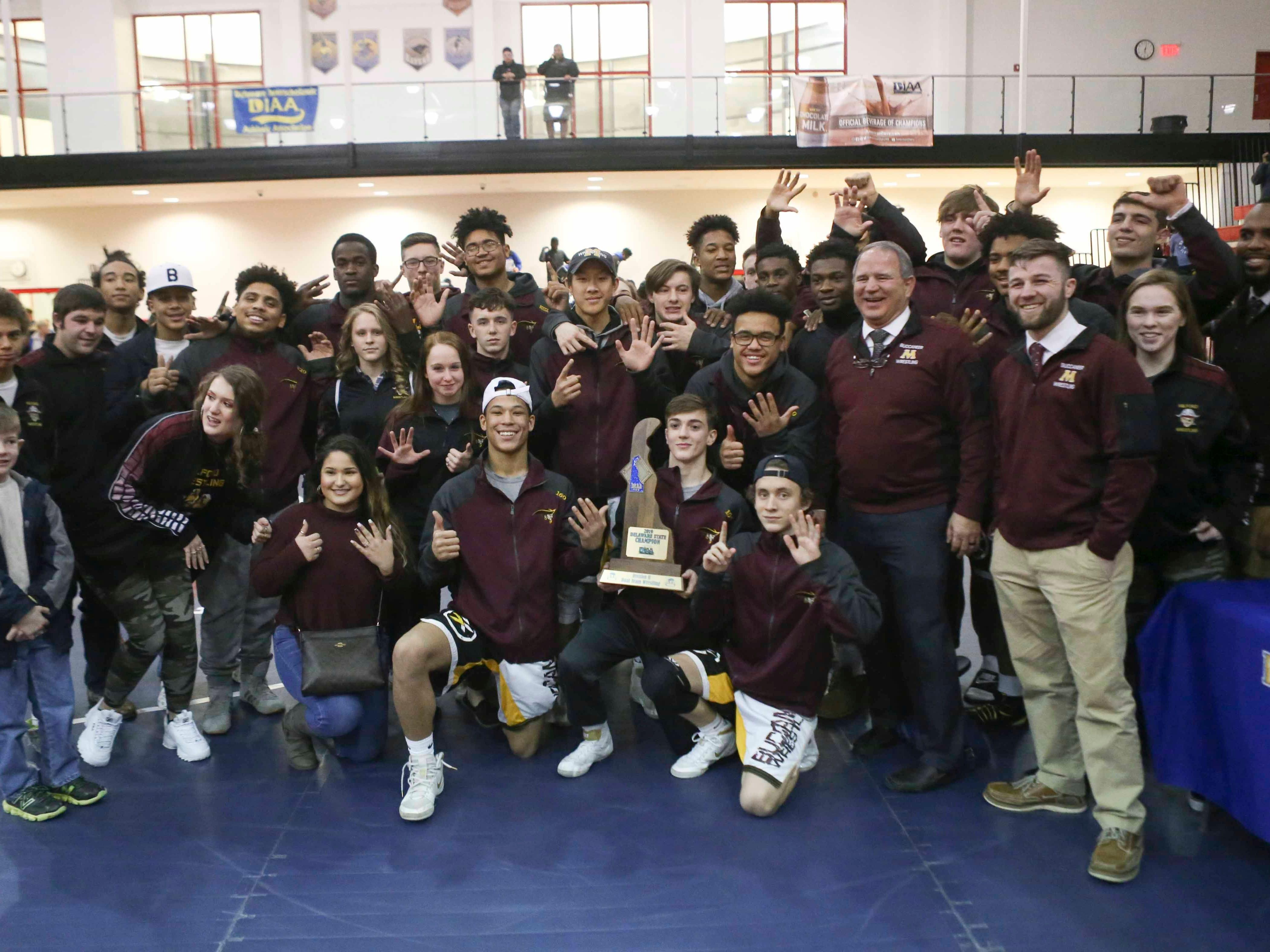 Milford celebrates its DIAA Division II team championship Saturday at Smyrna High School.