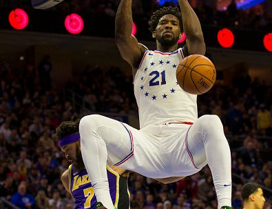 Joel Embiid #21 of the Philadelphia 76ers dunks the ball past JaVale McGee #7 of the Los Angeles Lakers in the first quarter at the Wells Fargo Center on February 10, 2019 in Philadelphia.