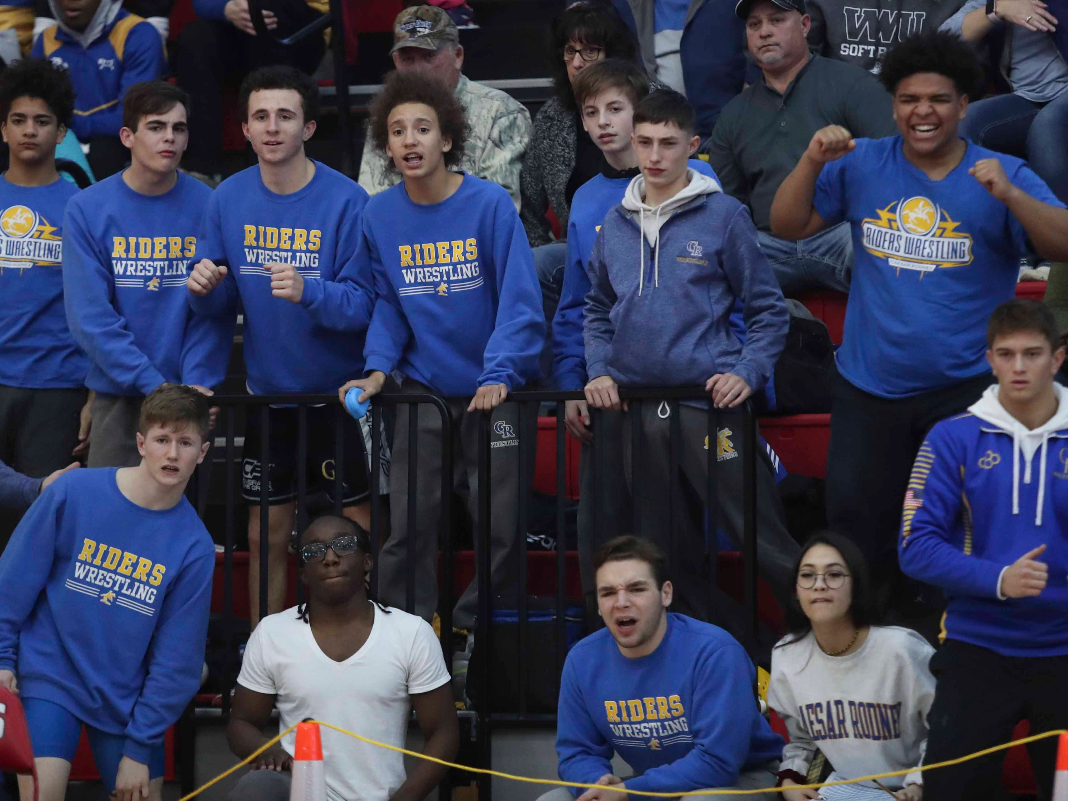 Riders fans and teammates cheer as Riley Tracey gets a pin at 160 pounds in the DIAA dual meet championships Saturday at Smyrna High School.