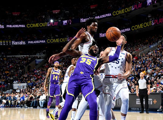 Reggie Bullock #35 of the Los Angeles Lakers goes for the ball against the Philadelphia 76ers on February 10, 2019 at the Wells Fargo Center in Philadelphia.