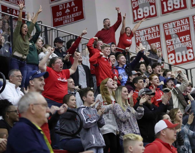 Smyrna fans cheer as Smyrna's Jaxson Al-Chokhachy holds on for a 3-2 win at 126 pounds in the DIAA dual meet championships Saturday at Smyrna High School.
