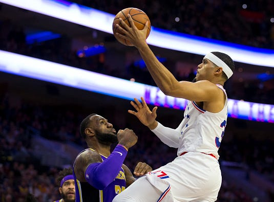 Tobias Harris #33 of the Philadelphia 76ers shoots the ball against LeBron James #23 of the Los Angeles Lakers in the first quarter at the Wells Fargo Center on February 10, 2019 in Philadelphia.