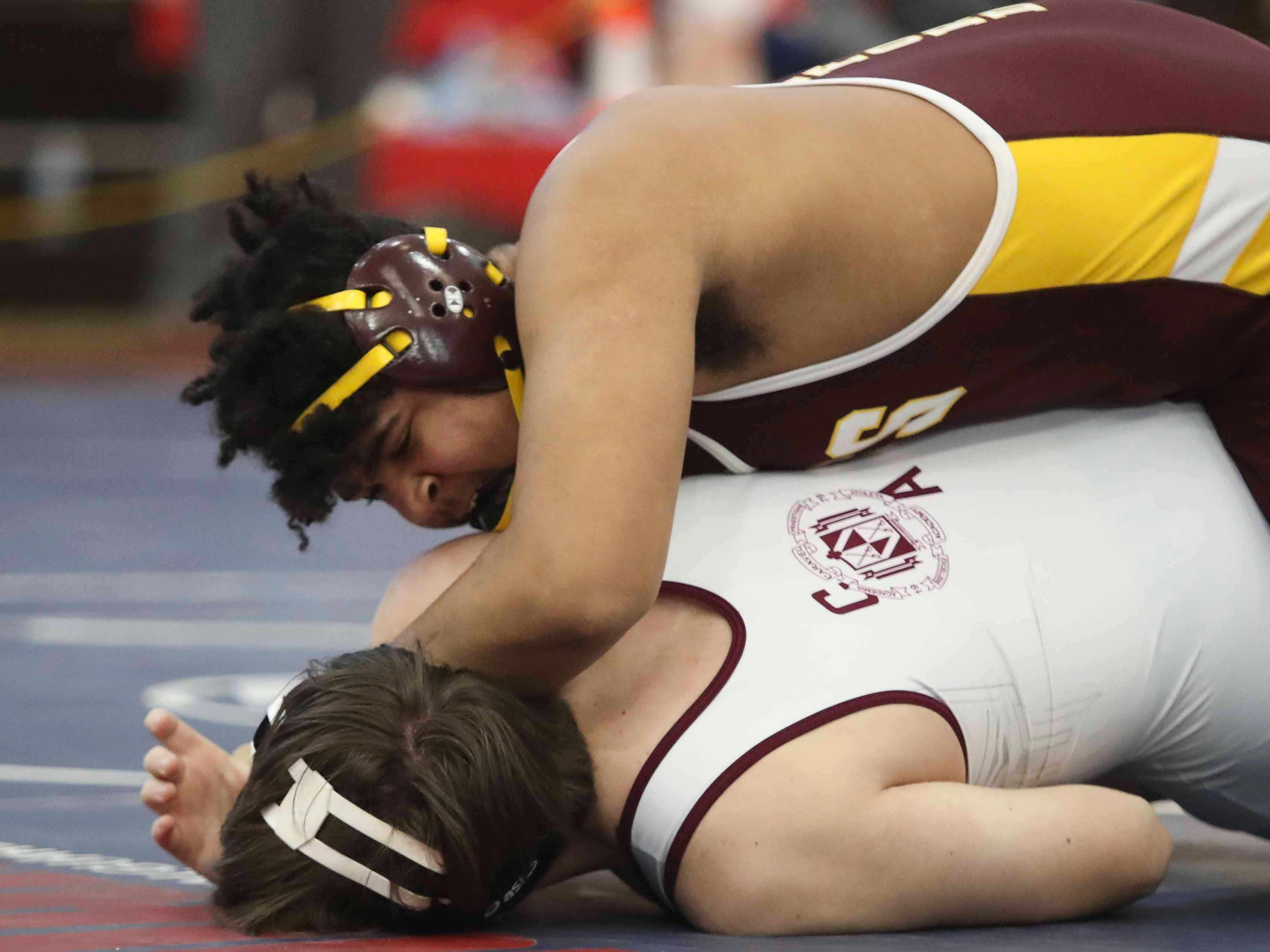Milford's Evonte Bennett moves to a pin of Caravel's Anthony Ranauto at 285 pounds in the finals of the DIAA Division II dual meet championships Saturday at Smyrna High School.