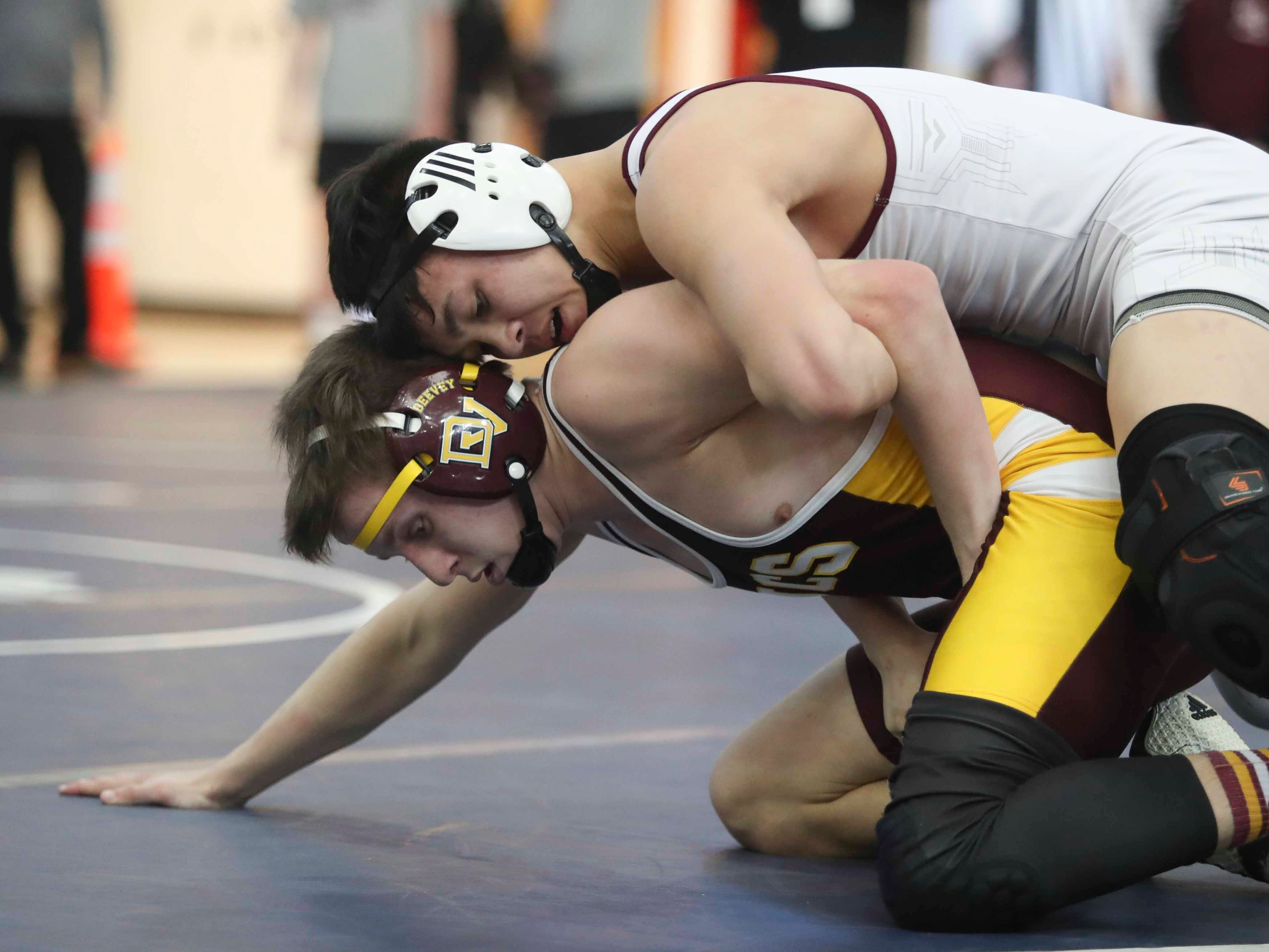 Caravel's Nicholas Hall top) works to a major decision over Milford's Dalton Deevey at 152 pounds in the finals of the DIAA dual meet championships Saturday at Smyrna High School.