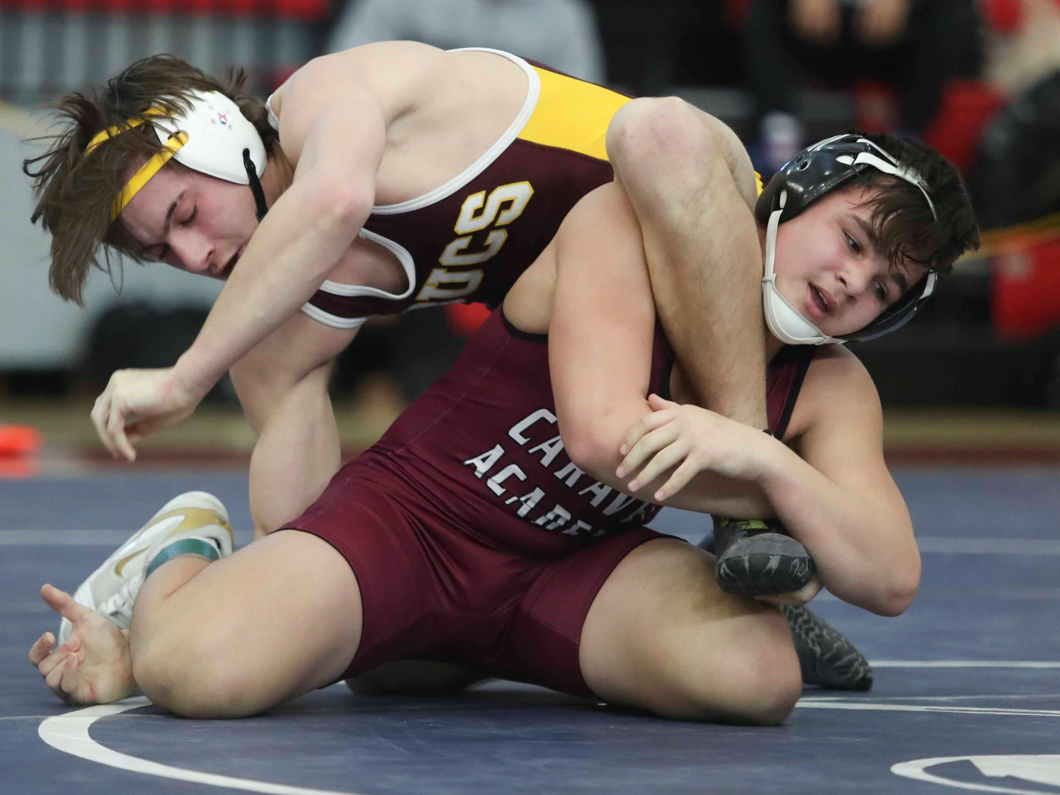 Milford's Jordan Passwaters works toward a win by decision against Caravel's Matt Duarte at 145 pounds in the final round of the DIAA dual meet championships Saturday at Smyrna High School.