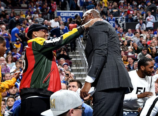 Allen Iverson talks with Magic Johnson during the game between the Philadelphia 76ers and the Los Angeles Lakers on February 10, 2019 at the Wells Fargo Center in Philadelphia, Pennsylvania.