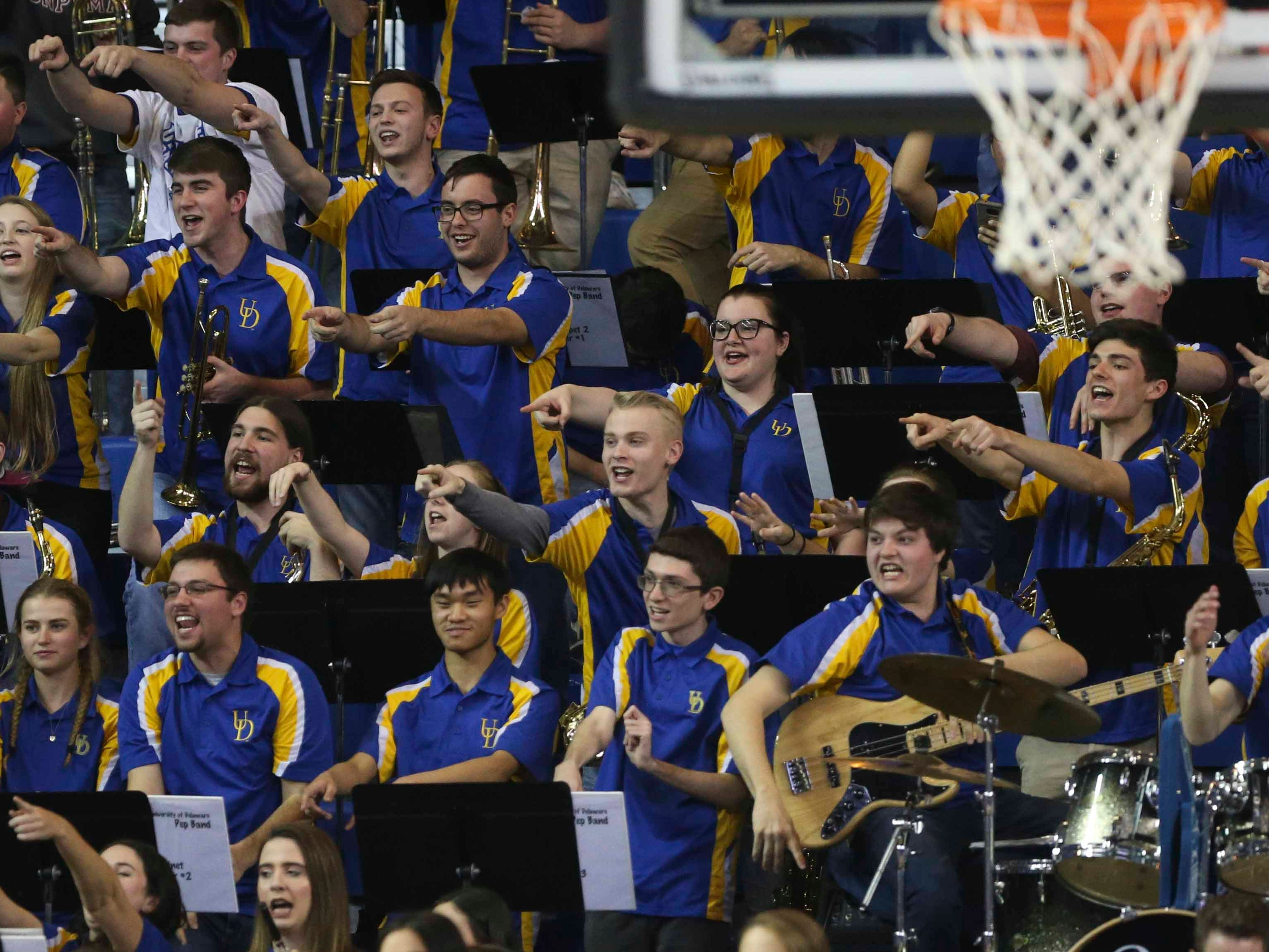 The Delaware band enjoys 'escorting' a UNC-Wilmington player to the bench after he fouled out in the second half of Delaware's 70-66 win at the Bob Carpenter Center Saturday.