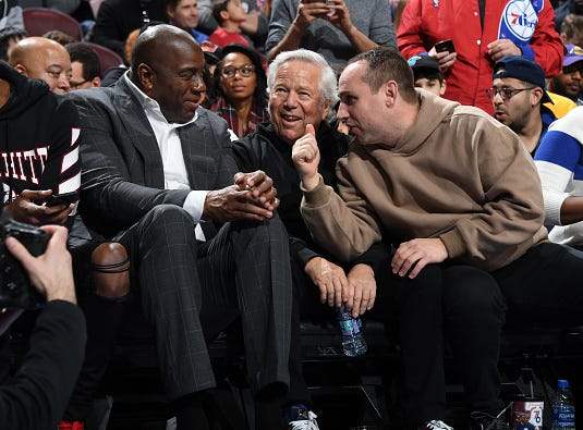 Owner Michael Rubin of the Philadelphia 76ers, and Owner Robert Kraft of the New England Patriots, and Owner Magic Johnson of the Los Angeles Lakers talk during the game the Philadelphia 76ers and the Los Angeles Lakers on February 10, 2019 at the Wells Fargo Center in Philadelphia, Pennsylvania.