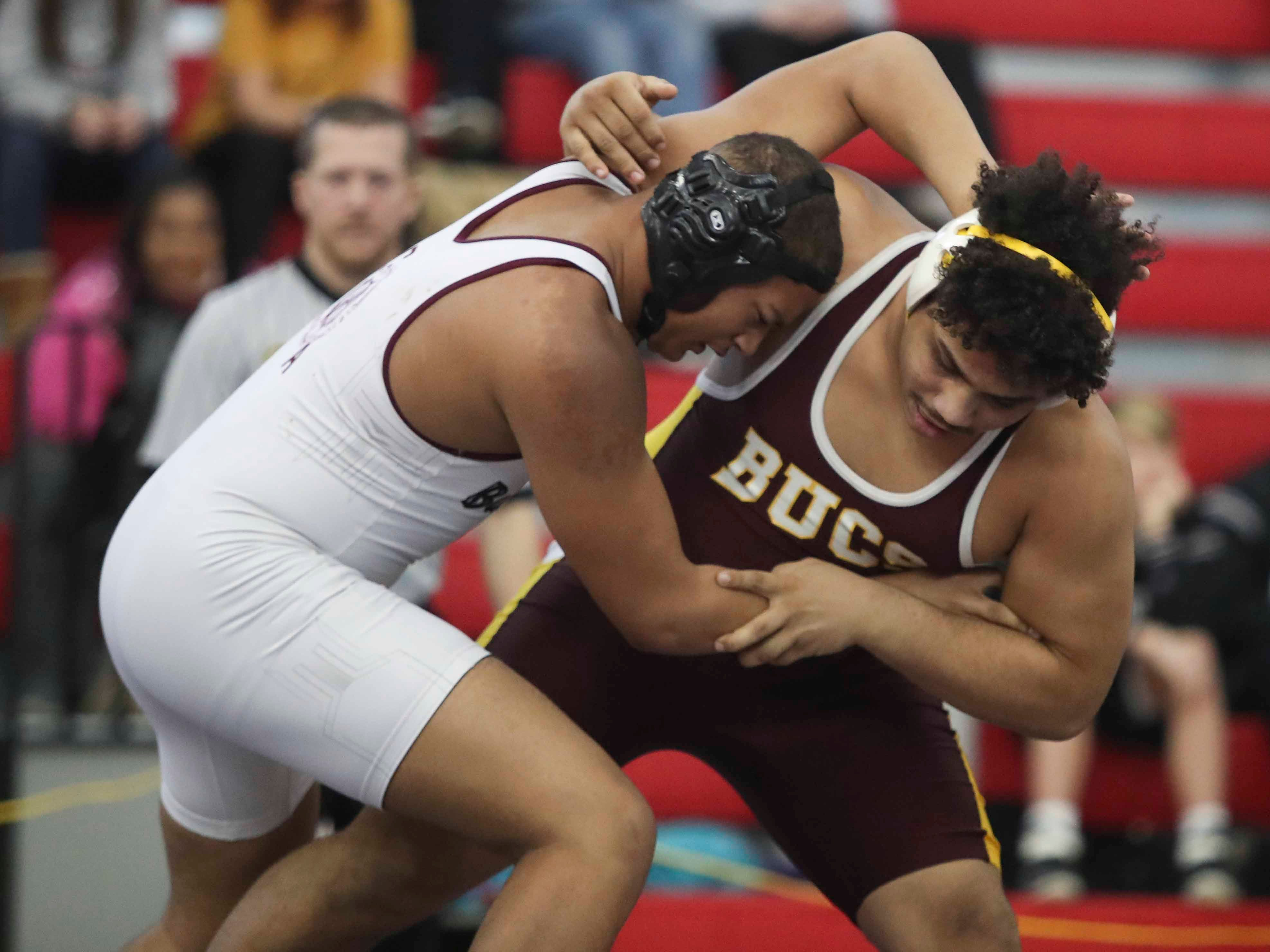 Milford's Anthony Diaz (right) gets a win against Caravel's A.J. Smith in the DIAA Division II dual meet championships Saturday at Smyrna High School.