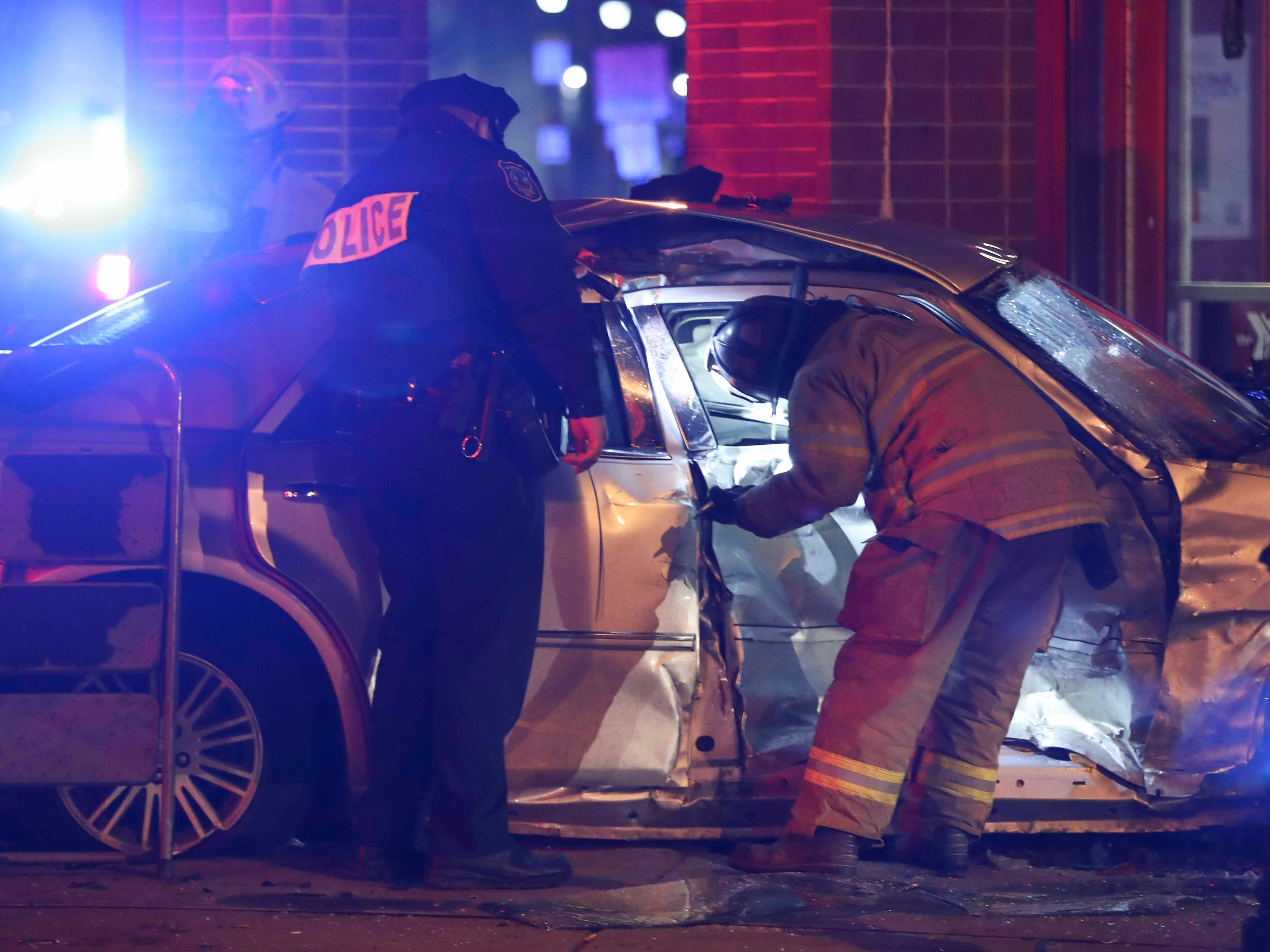 Wilmington police officers and fire fighters work in the aftermath of a two-vehicle accident that injured several people at the intersection of E. 10th and Walnut Streets about 10:15 p.m. Saturday.