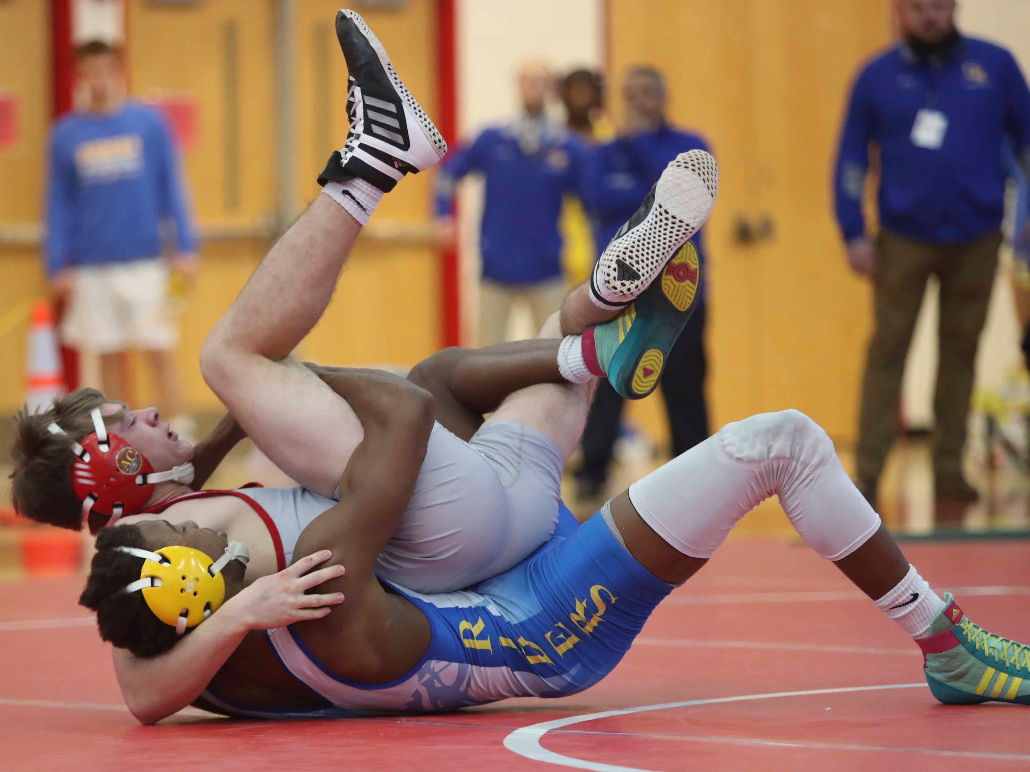 Caesar Rodney's Gabriel Degraffinreed (bottom) works to a pin on Smyrna's Logan Kosky at 152 pounds in the DIAA dual meet championships Saturday at Smyrna High School.