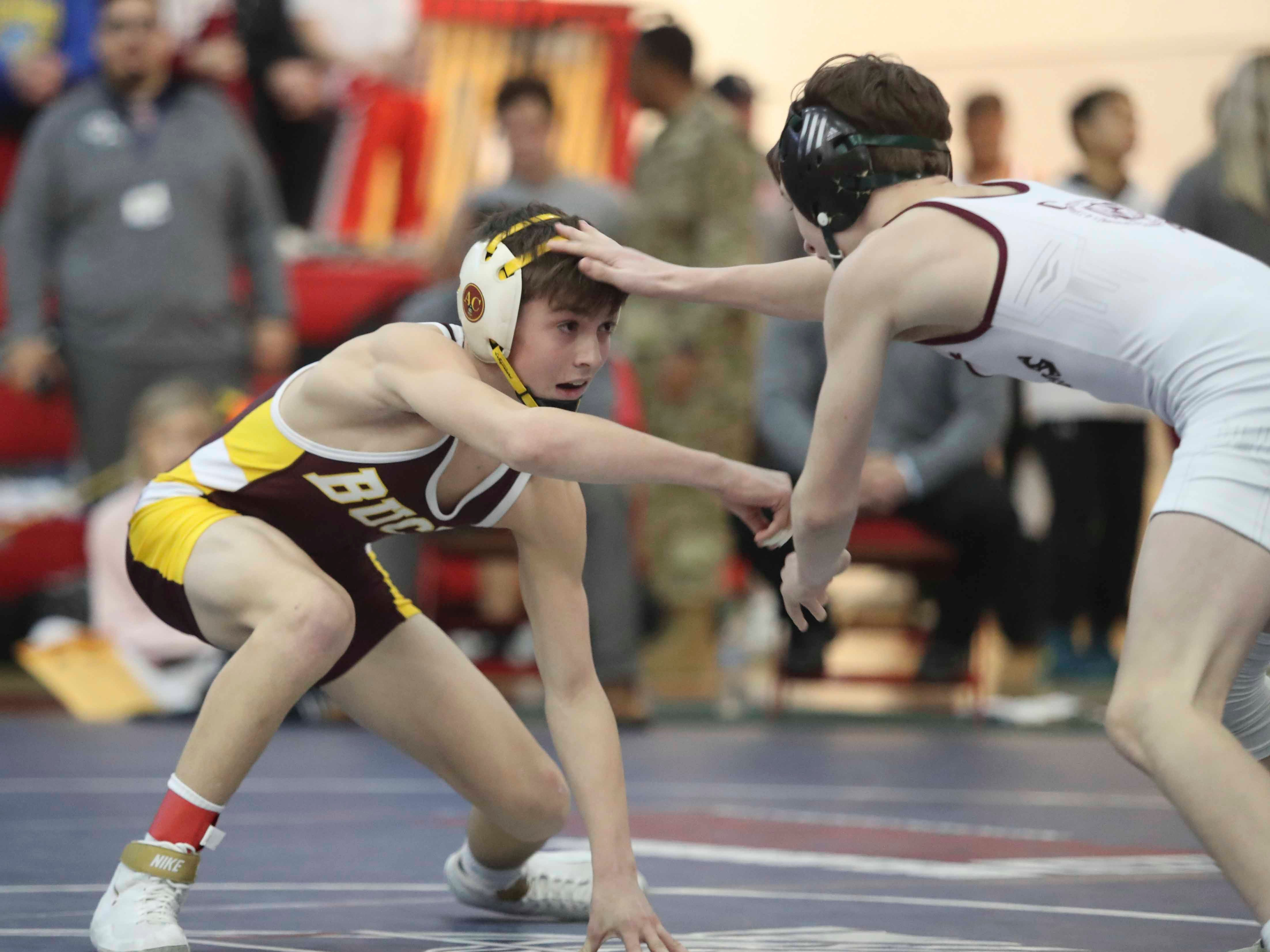 Milford's Corey Messick (left) works with Caravel's Luke Poore before Poore won a 2-0 decision at 106 pounds in the finals of the DIAA Division II dual meet championships Saturday at Smyrna High School.