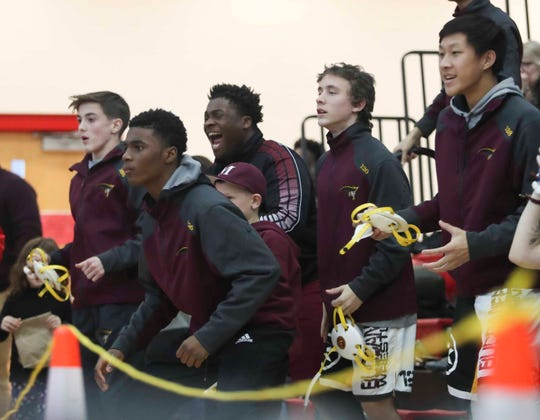 Milford team members cheer en route to their title in the DIAA Division II dual meet championships Saturday at Smyrna High School.