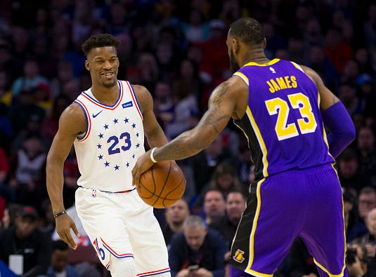 Jimmy Butler #23 of the Philadelphia 76ers guards LeBron James #23 of the Los Angeles Lakers in the first quarter at the Wells Fargo Center on February 10, 2019 in Philadelphia.
